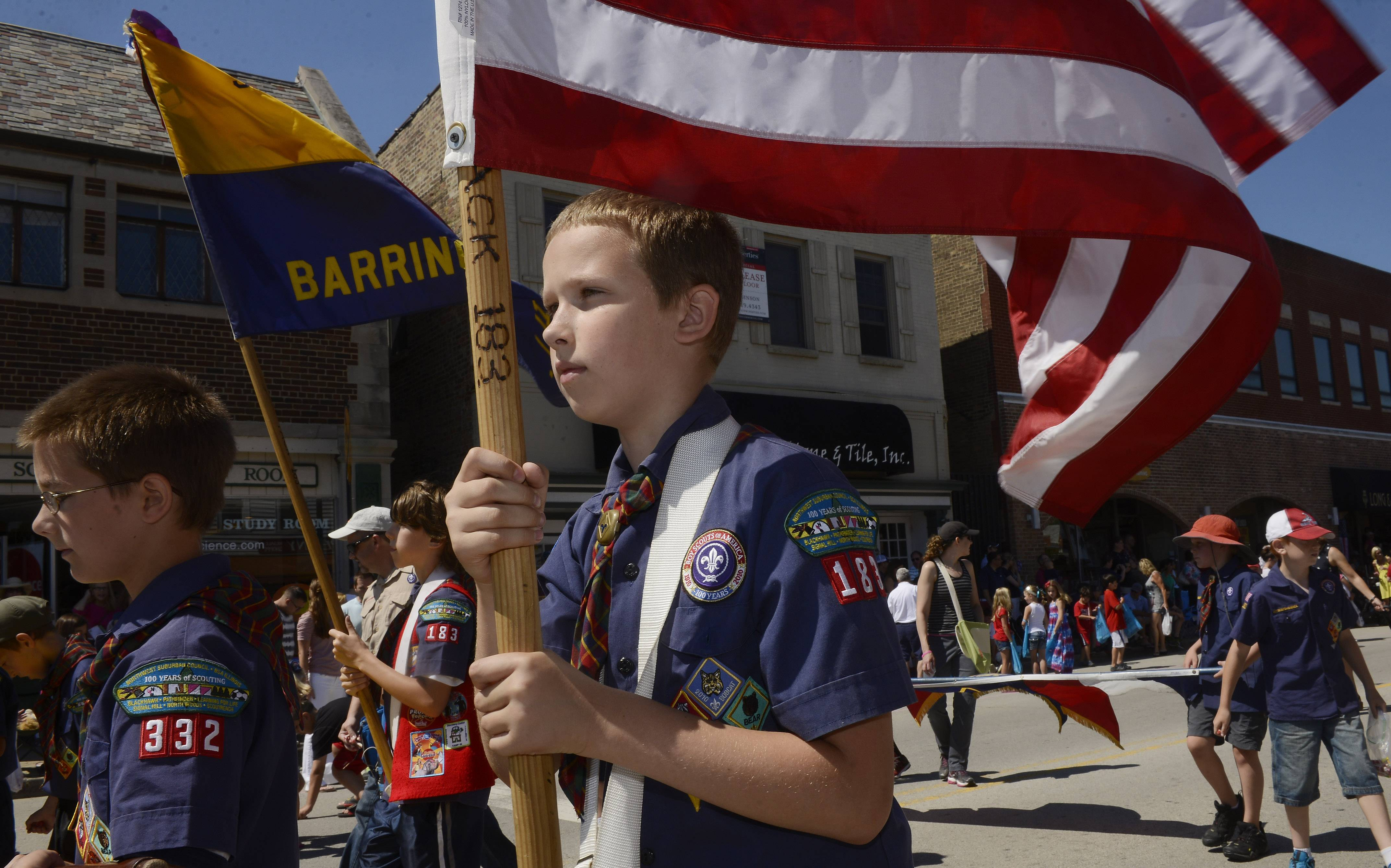 Alex Ziegler, 10, of Cub Scout Troop 183 carries the United States flag during the Barrington Fourth of July parade Friday.