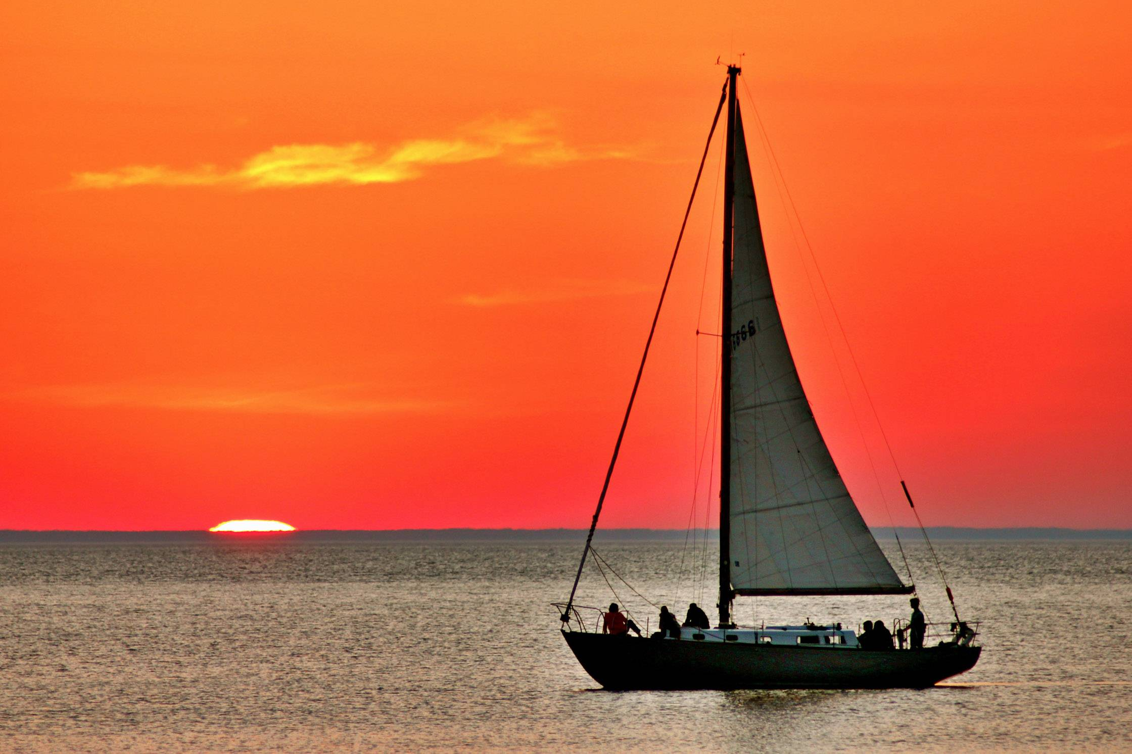 A red sky glows around a sailboat in Sister Bay, Wisconsin on June 9th, 2012 at 8:47 p.m.
