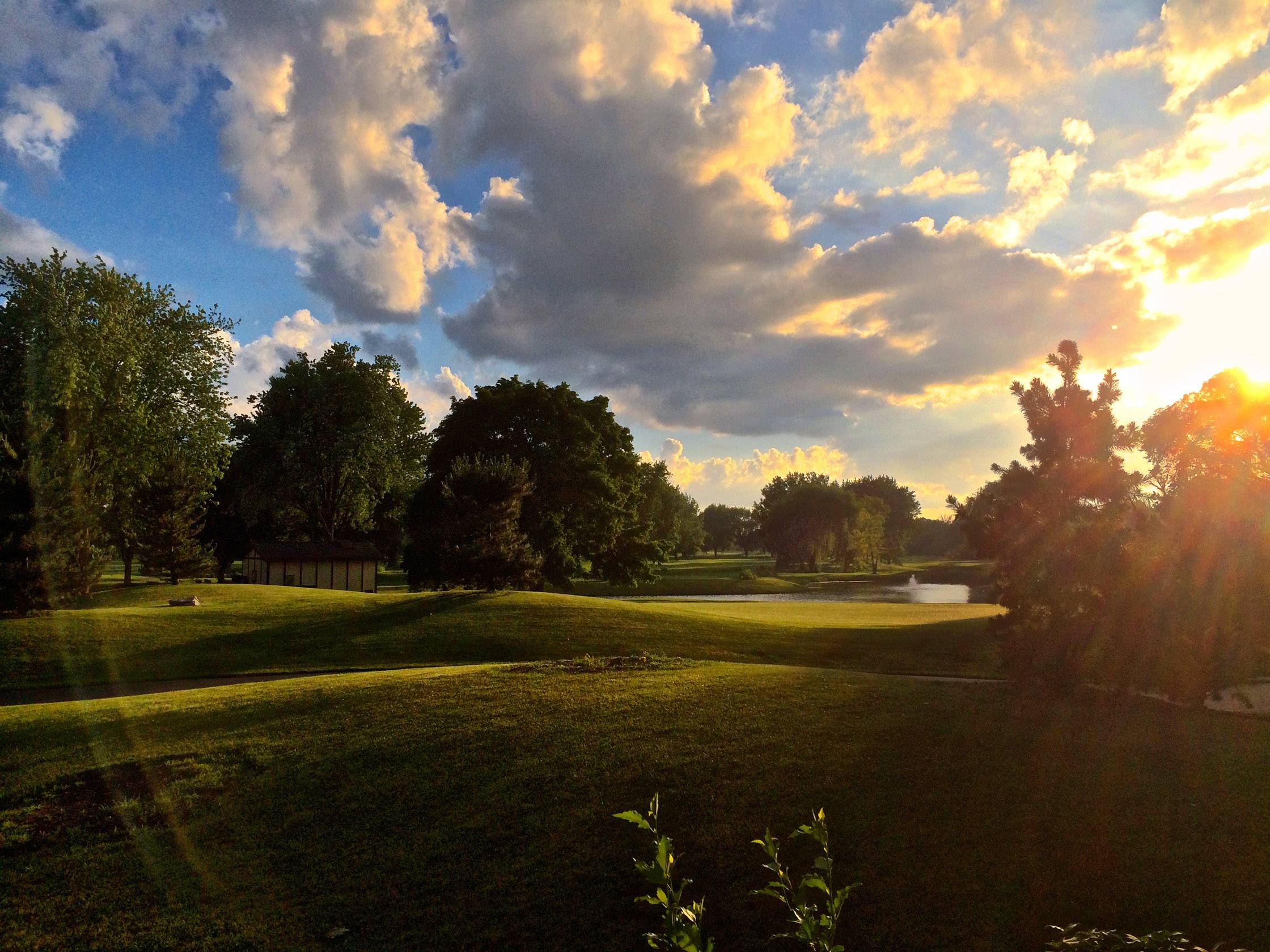 The sun sets on the golf course after a wedding at the Chevy Chase Golf Club in Wheeling last month.