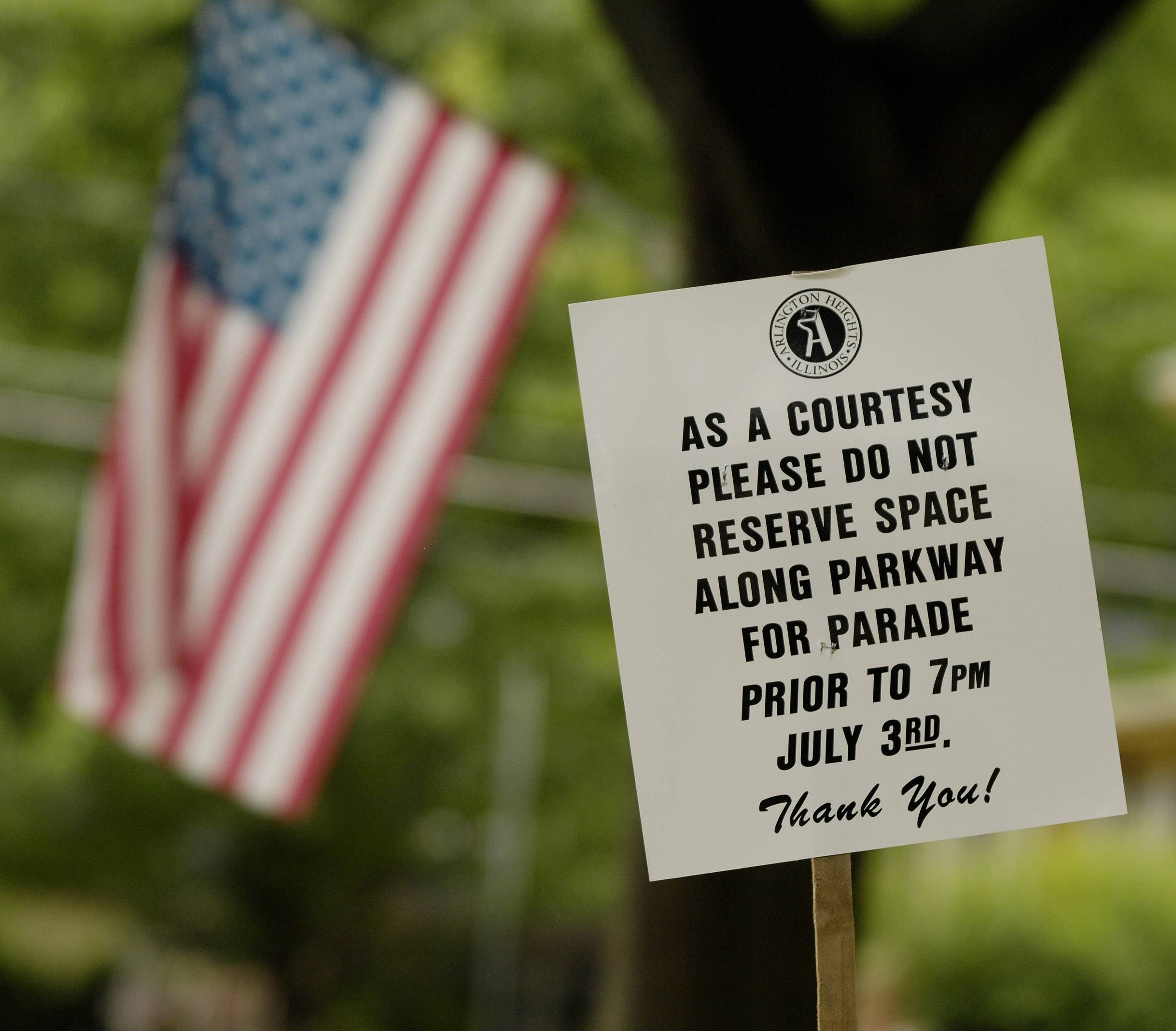 Signs posted along Dunton Avenue in Arlington Heights warn Fourth of July paradegoers not to reserve spaces along the parkway prior to 7 p.m. July 3rd.