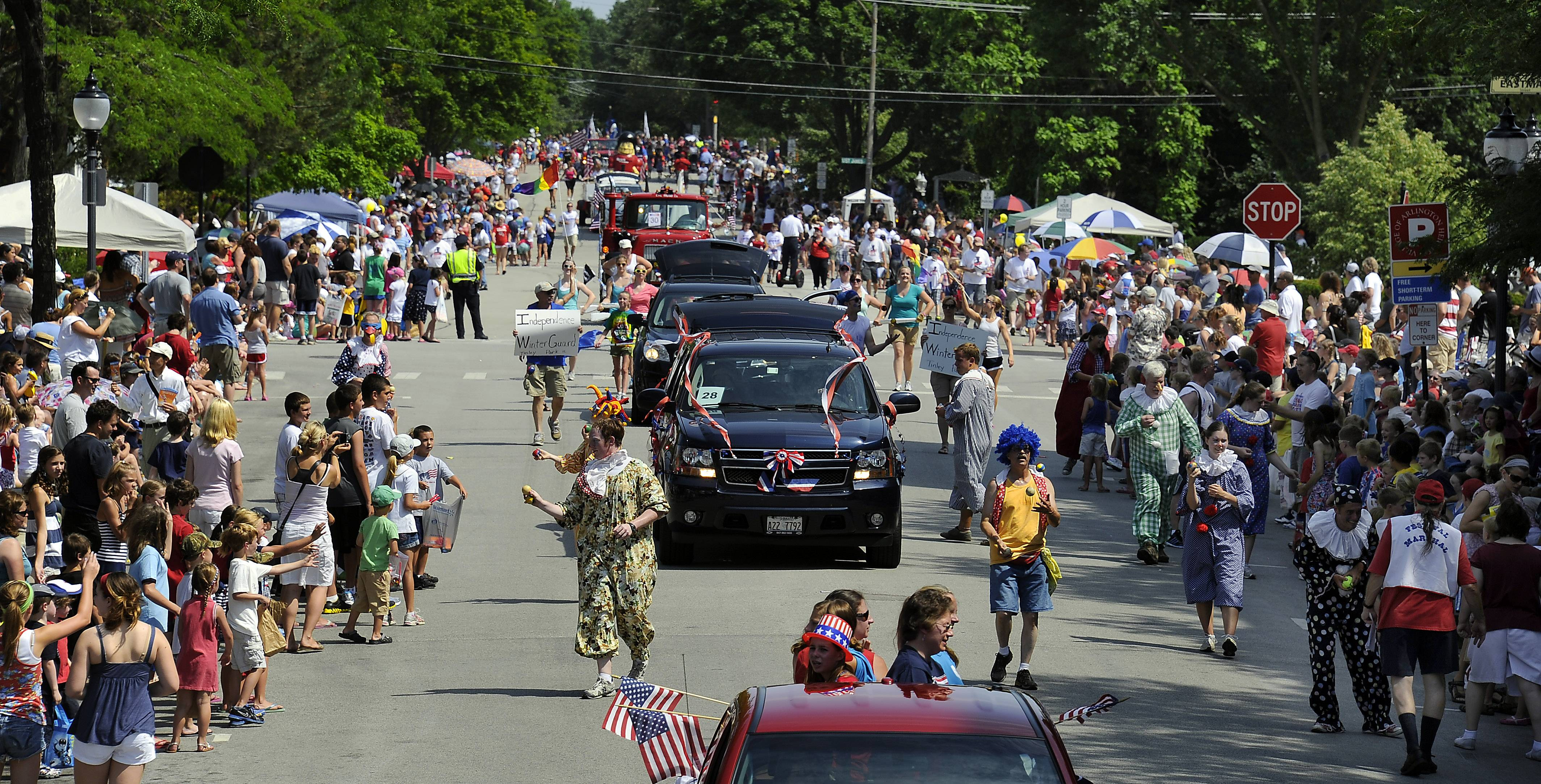 A mass of humanity floods the streets during the Fourth of July parade in Arlington Heights.