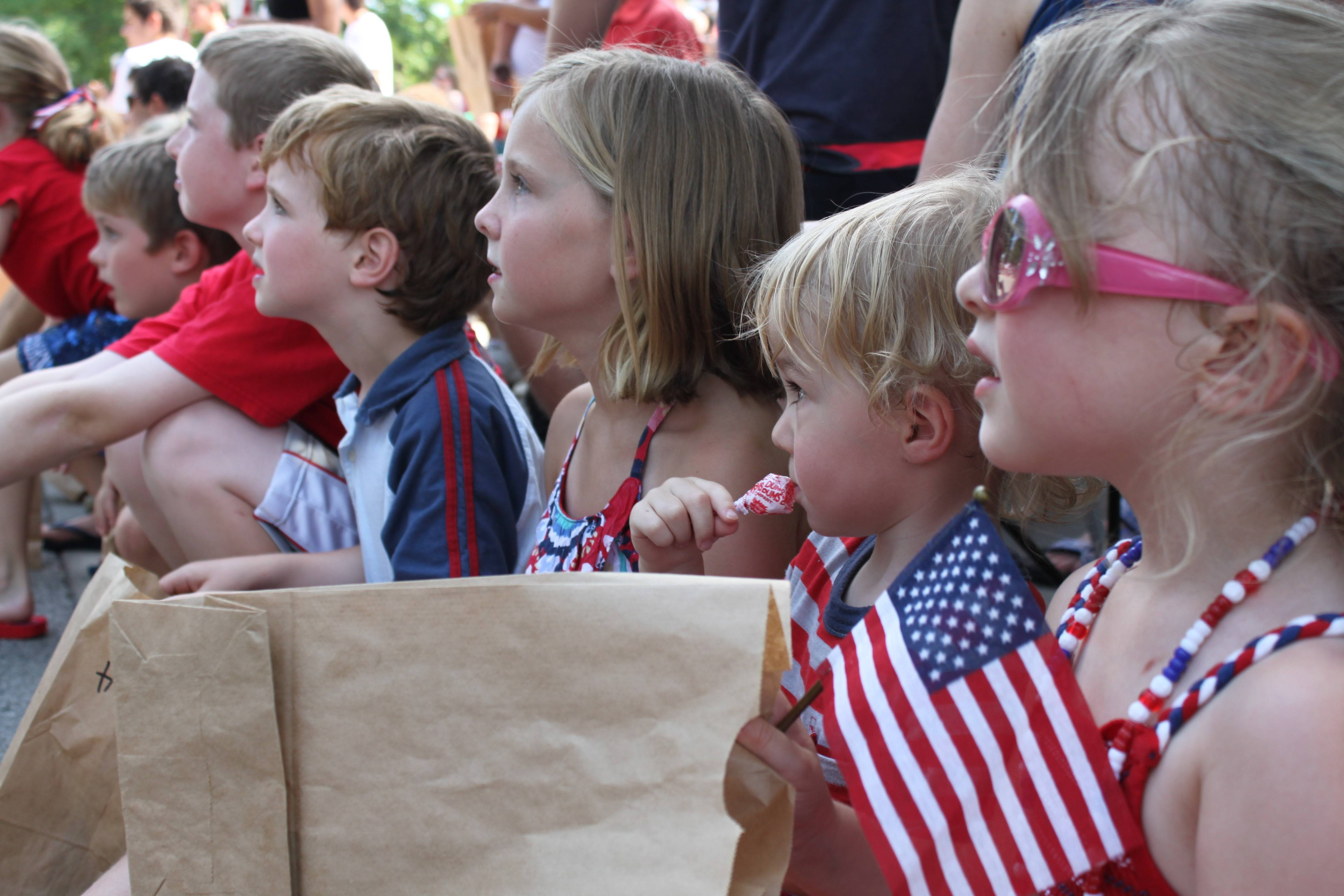 Children line Dunton Avenue in Arlington Heights for the annual Fourth of July parade.
