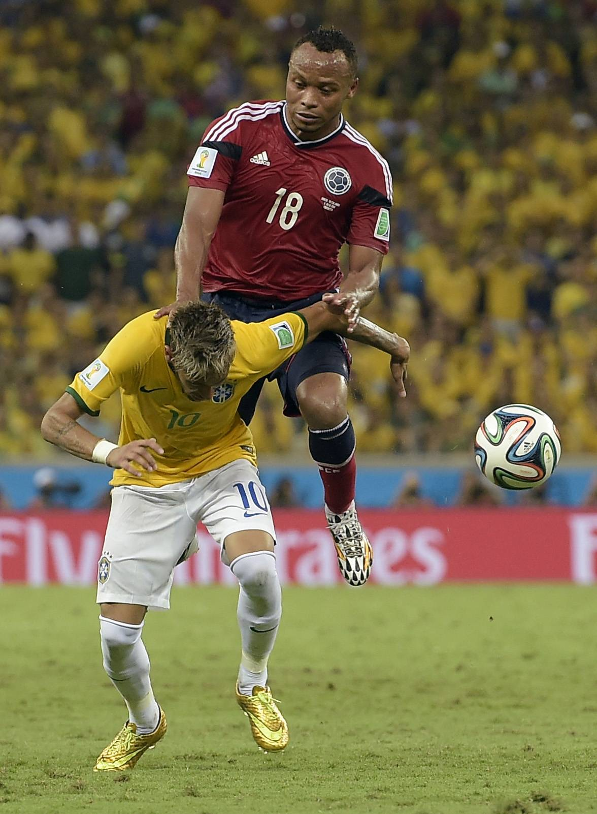 Brazil's Neymar is fouled by Colombia's Juan Zuniga during the World Cup quarterfinal soccer match between Brazil and Colombia at the Arena Castelao in Fortaleza, Brazil, Friday, July 4, 2014. Brazil's team doctor says Neymar will miss the rest of the World Cup after breaking a vertebrae during the team's quarterfinal win over Colombia.