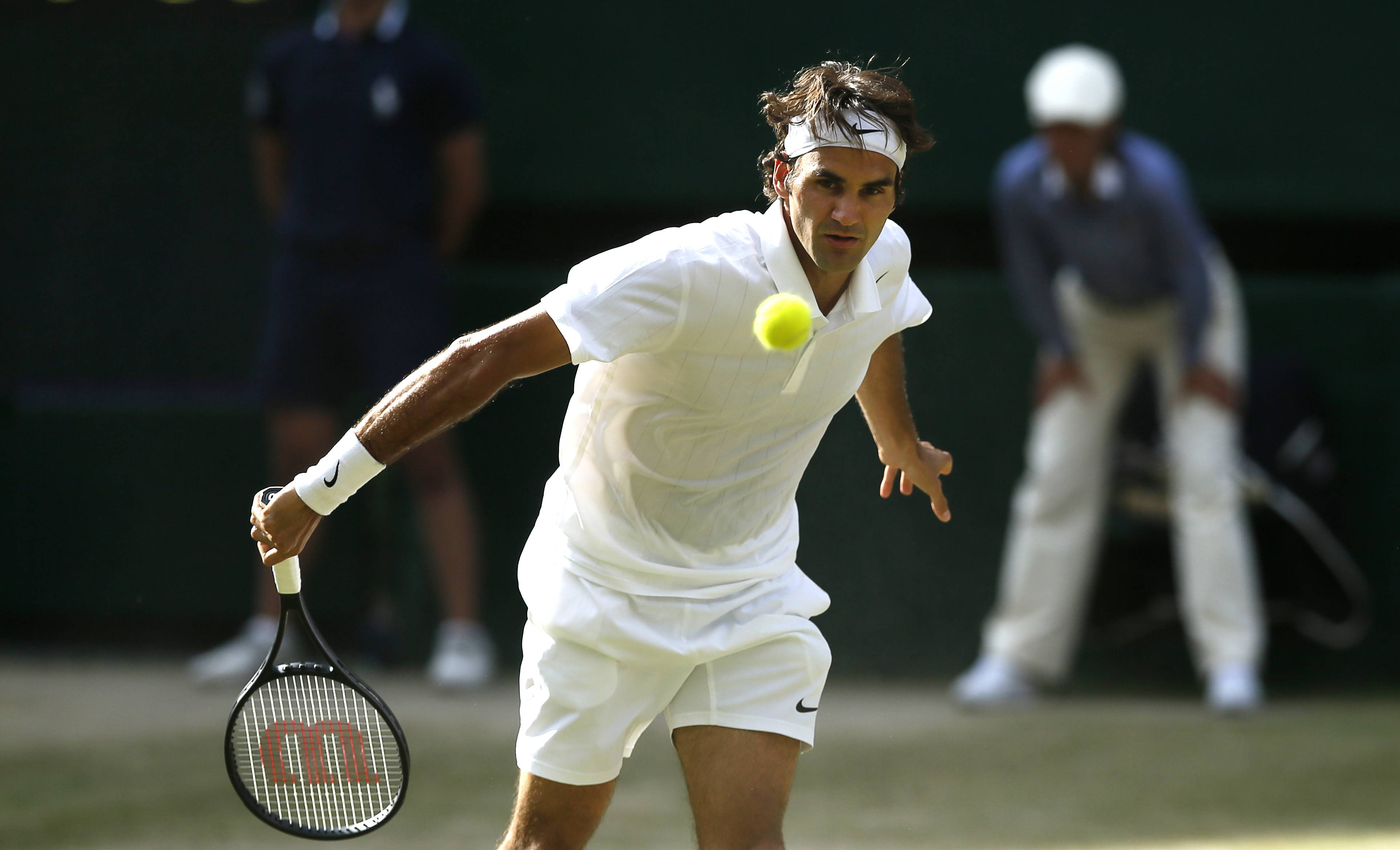 Roger Federer watches his return to Milos Raonic during their men's semifinal match Friday at Wimbledon.