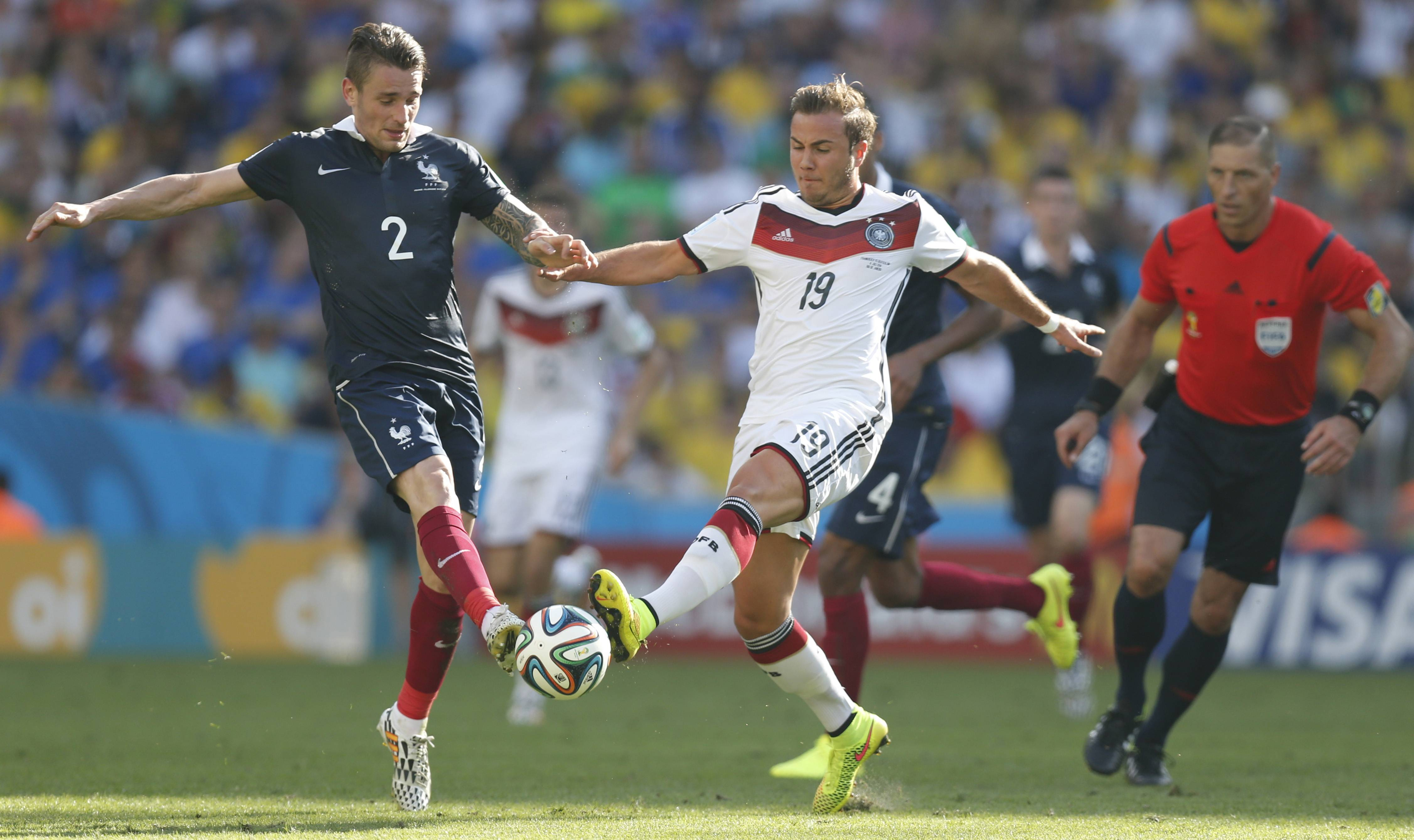 Germany's Mario Goetze and France's Mathieu Debuchy challenge for the ball during their World Cup quarterfinal match Friday at Maracana Stadium in Rio de Janeiro, Brazil.