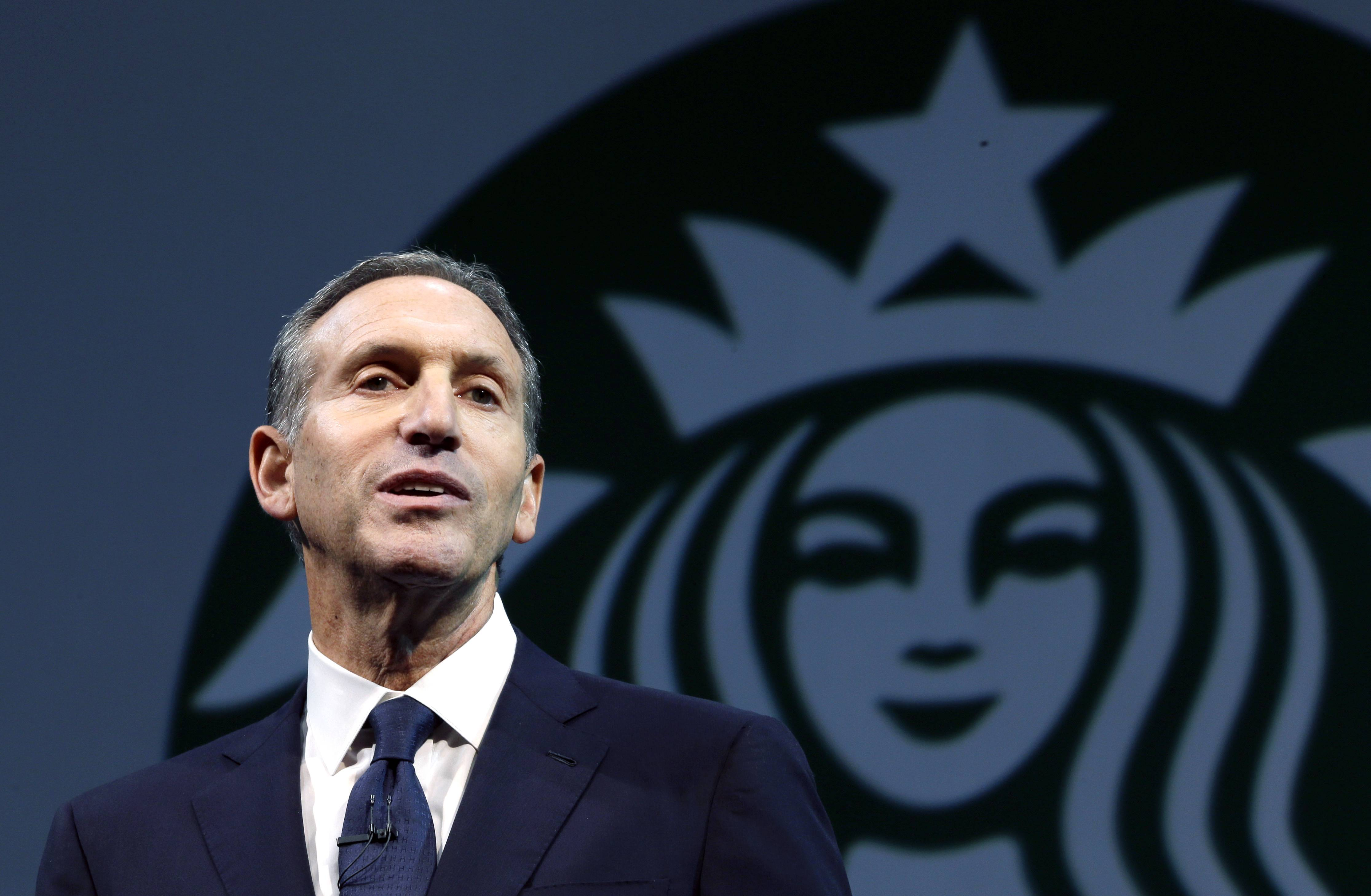 "Starbucks CEO Howard Schultz speaks at the company's annual shareholders meeting, in Seattle, Wash. Schultz is collaborating on a book about veterans of the wars in Iraq and Afghanistan. ""For Love of Country: What Our Veterans Can Teach Us About Citizenship, Heroism, and Sacrifice"" will be published by Alfred A. Knopf on Nov. 4."