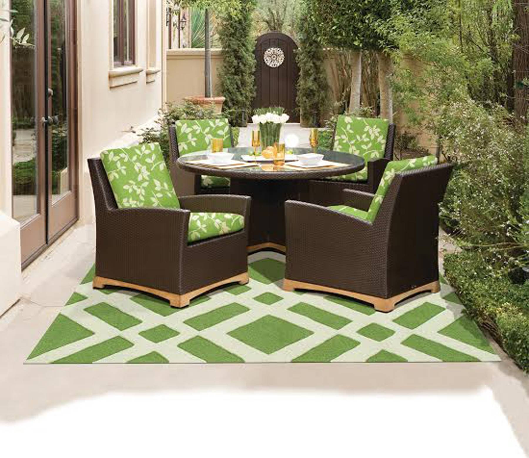New fabrics, furniture and rugs shrug off the elements, making outdoor living as colorful and comfortable as, well, the great outdoors.