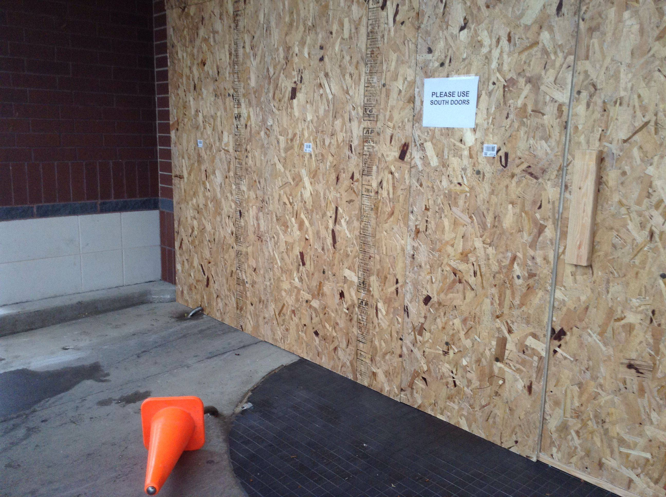 The north entrance of Garden Fresh Market in Buffalo Grove is boarded up Saturday after a driver crashed her SUV through a revolving glass door.