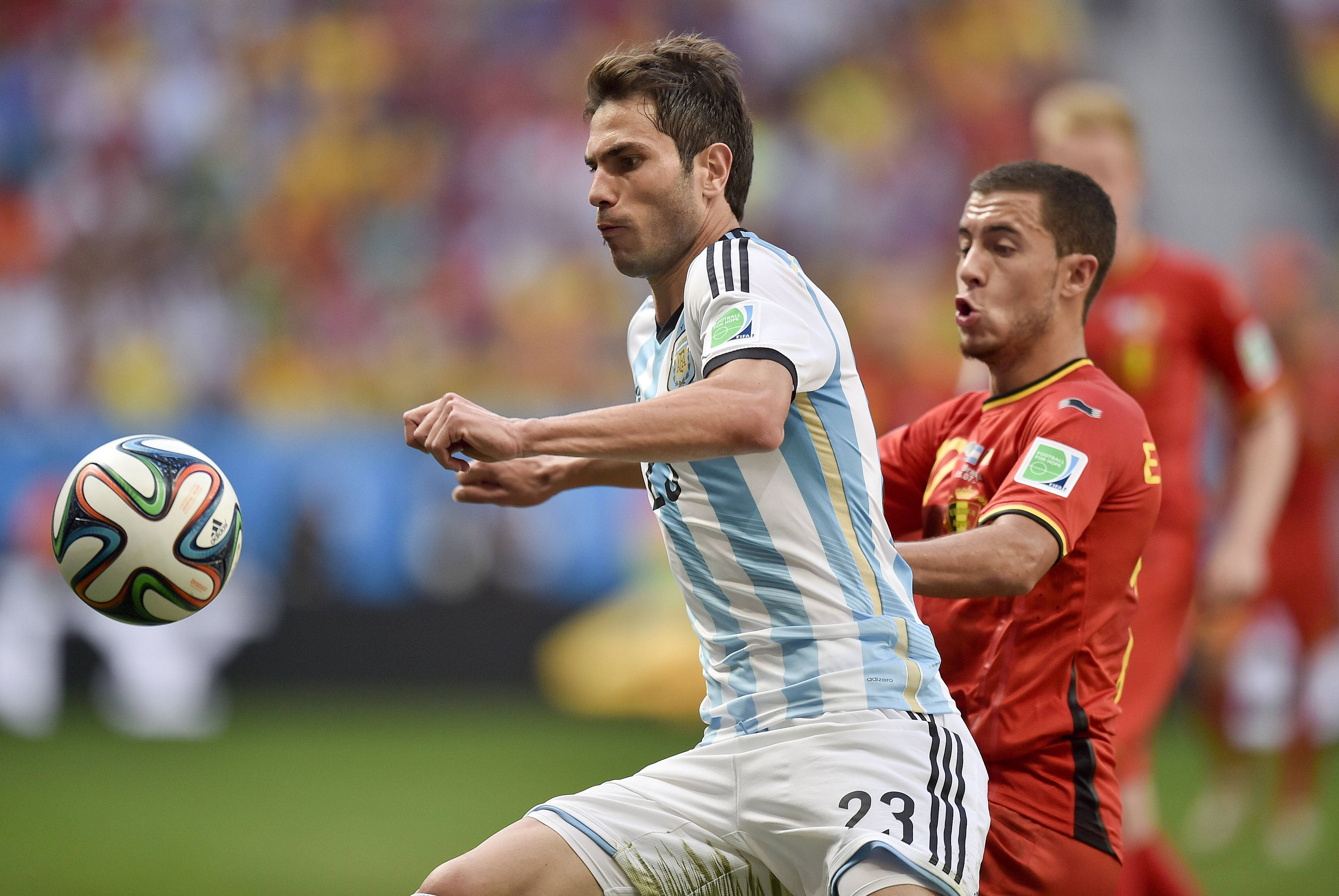 Argentina's Jose Maria Basanta, left, is challenged by Belgium's Eden Hazard during their World Cup quarterfinal soccer Saturday at the Estadio Nacional in Brasilia, Brazil.