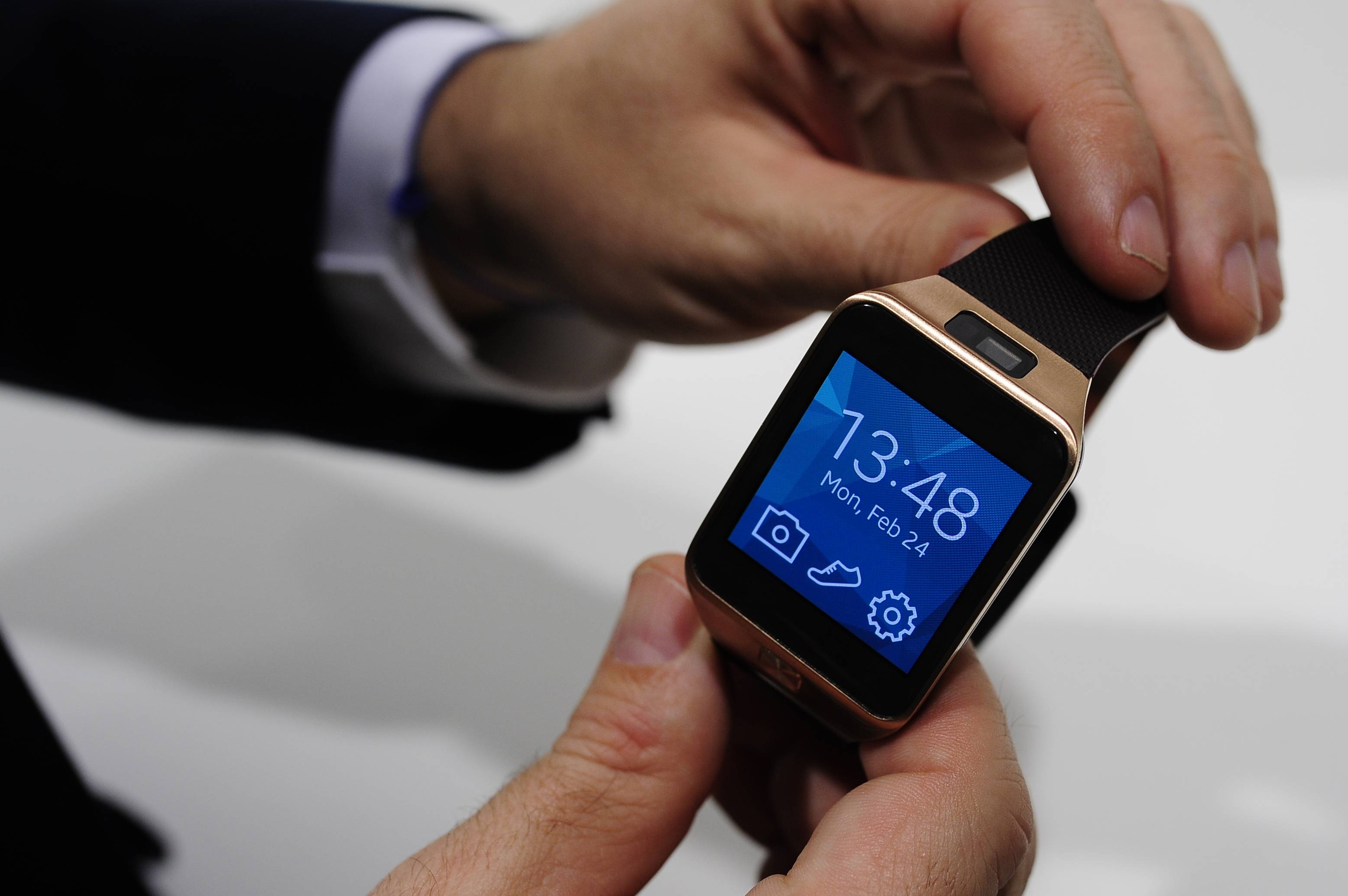 In this Feb. 24, 2014 file photo, the Samsung Gear 2 smartwatch is displayed at the Mobile World Congress in Spain. The Gear 2 line doesn't use Android Wear, but a fledging system called Tizen. Samsung says that helps extend battery life to two or three days, instead of the single day on the original, Android-based Galaxy Gear. Unlike the Android Wear watches, the Gear 2 and the Gear 2 Neo both require a Samsung phone.