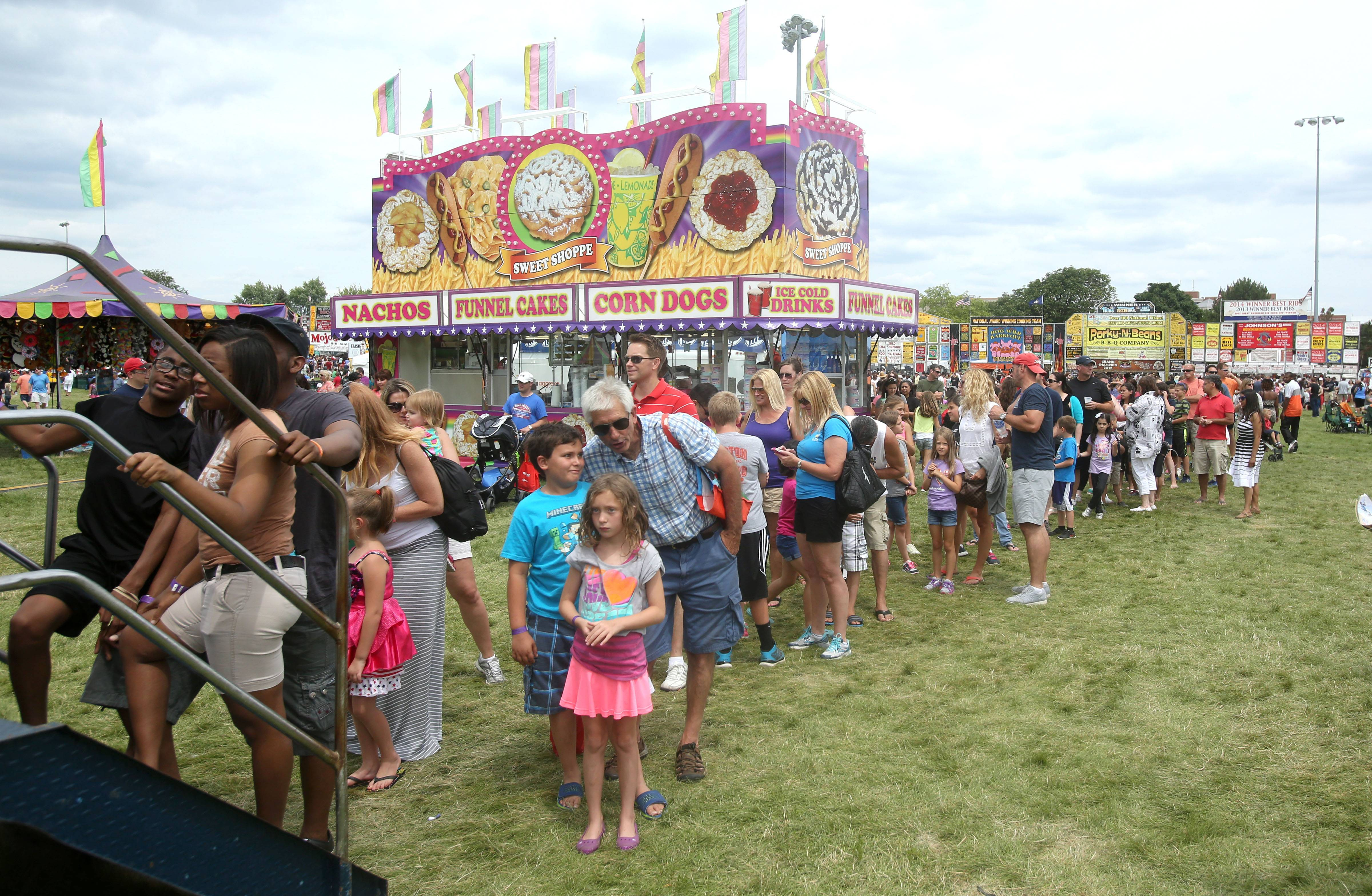 Long lines were worth the wait for many in the carnival area at the first Hispanic Day at Ribfest in Naperville.