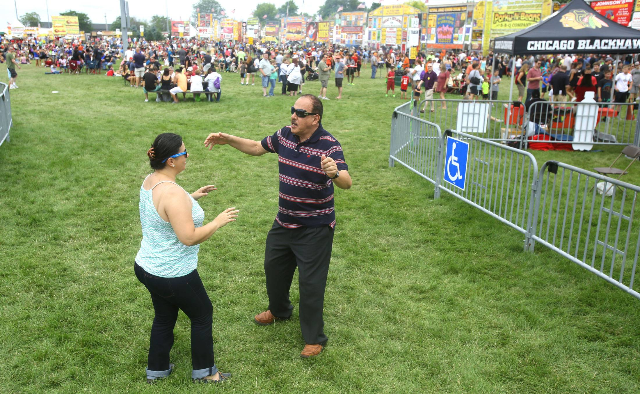 Leonor Castro and Pedro Sanchez dance to the music of Rio Bamba during the first Hispanic Day at Ribfest in Naperville.