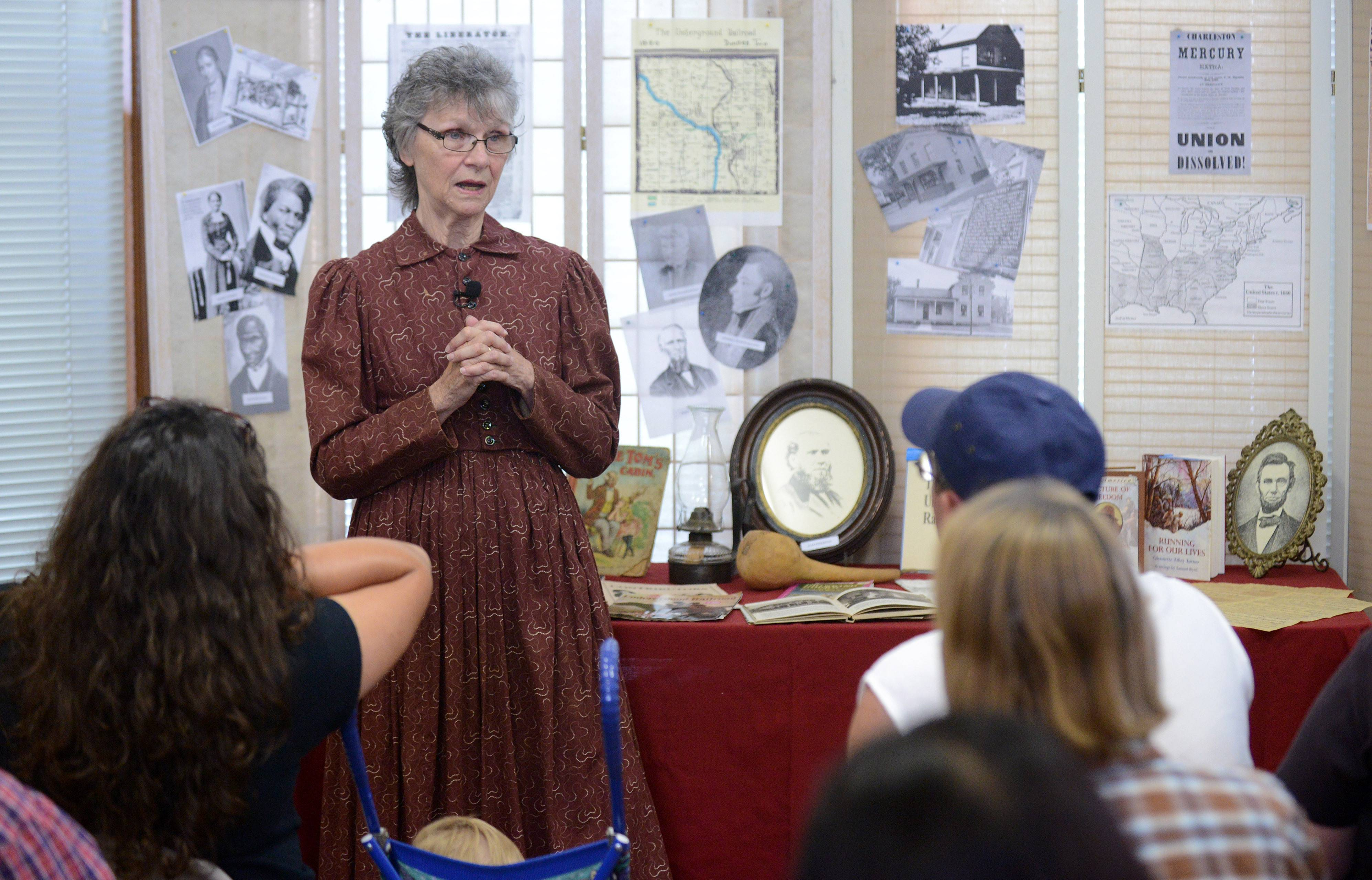 Marge Edwards of the Dundee Township Historical Society talks about the Underground Railroad and local citizens who helped slaves escape to freedom at The Depot Museum on Saturday.