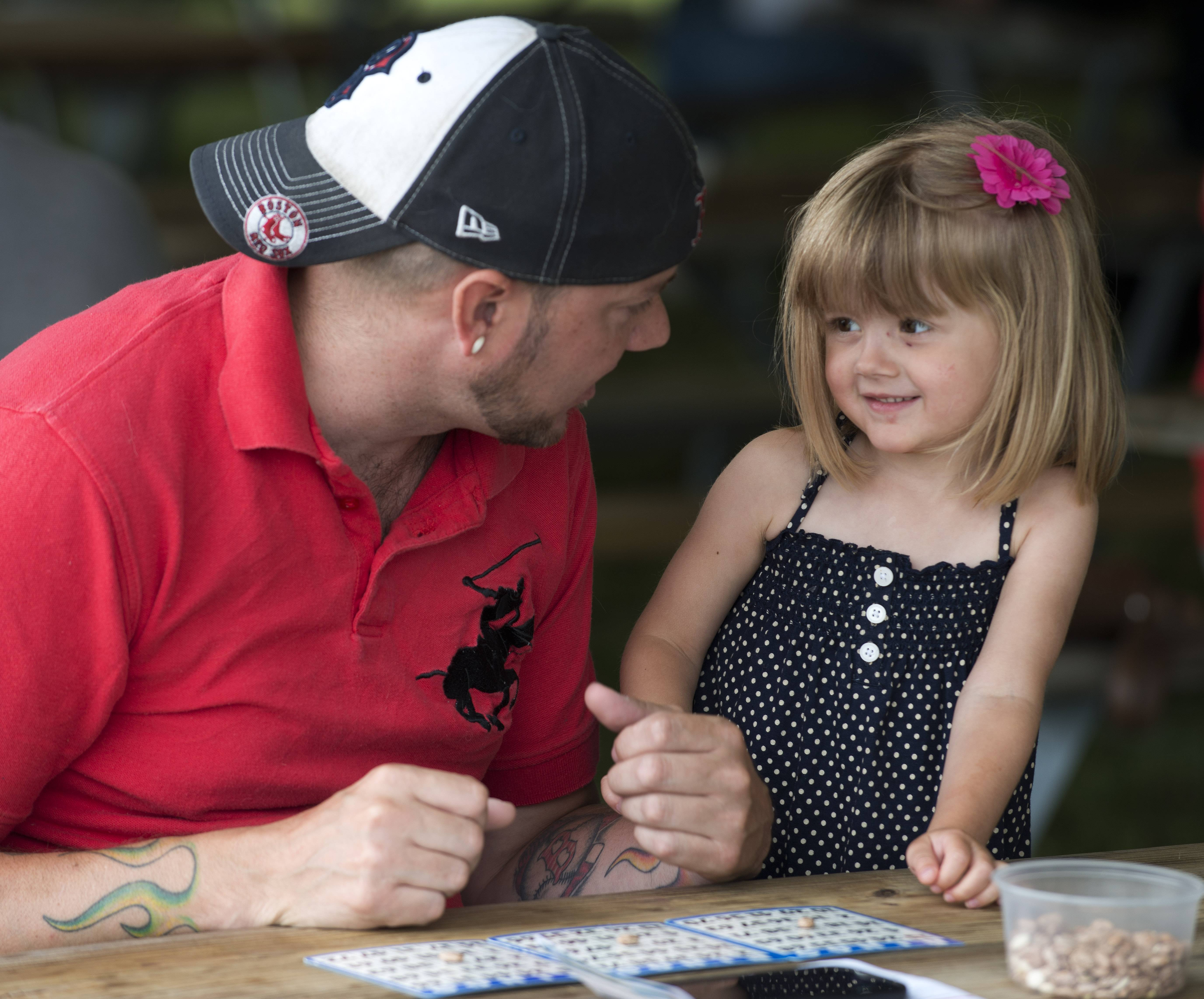 Vivianne Kehrer, 3, of Mundelein is set to play a round of bingo with her dad, Robert, Saturday during day three of Mundelein Community Days.