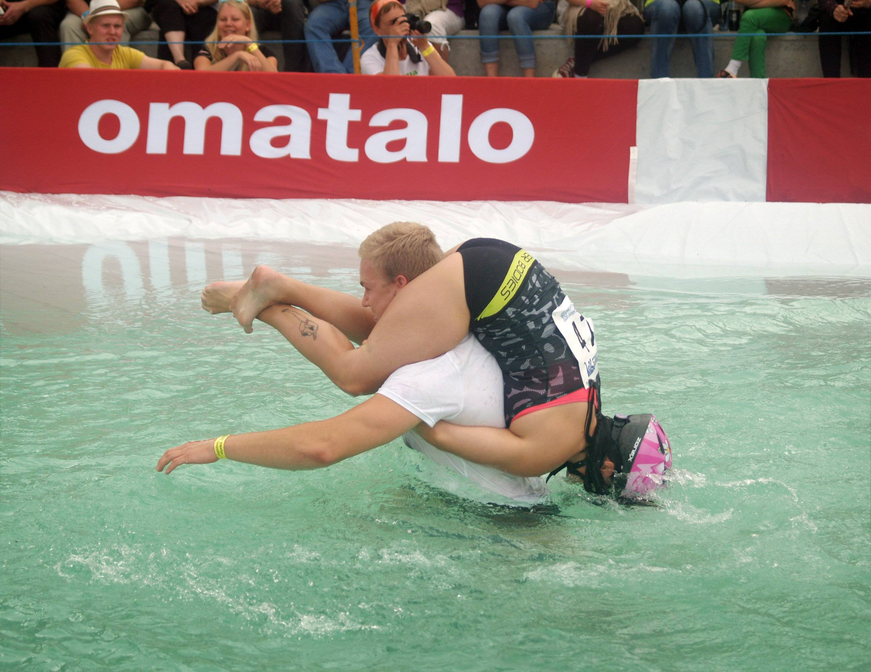 Ville Parviainen and Janette Oksman from Vantaa, Finland go on Saturday to win the Wife Carrying World Championships, held in Sonkajarvi, Finland.