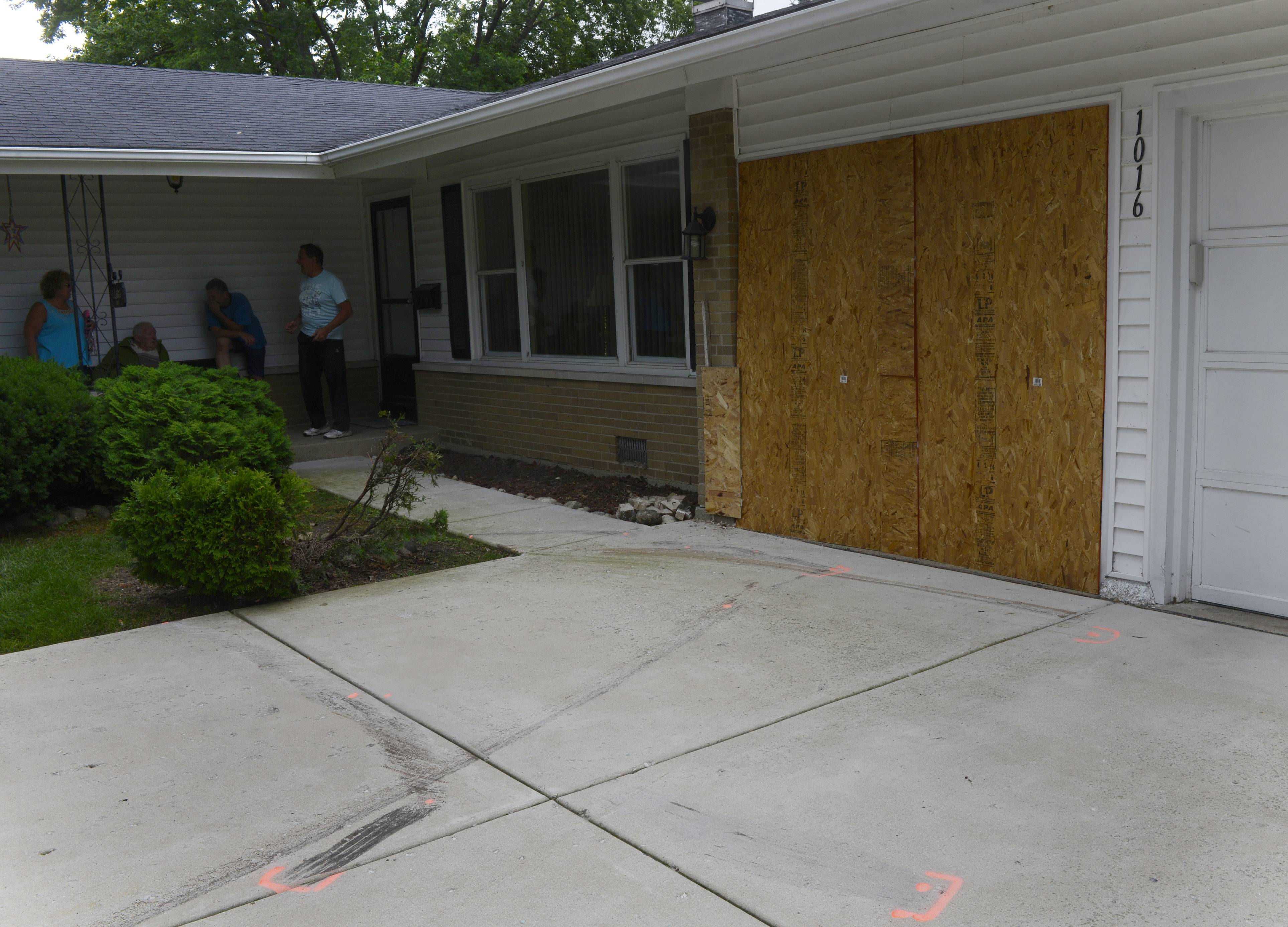 A car struck a house on the 1000 block of Cypress Lane in Elk Grove Village early Saturday morning. Residents of the home were not injured, but two of the four people who were in the car suffered serious injuries, police said.
