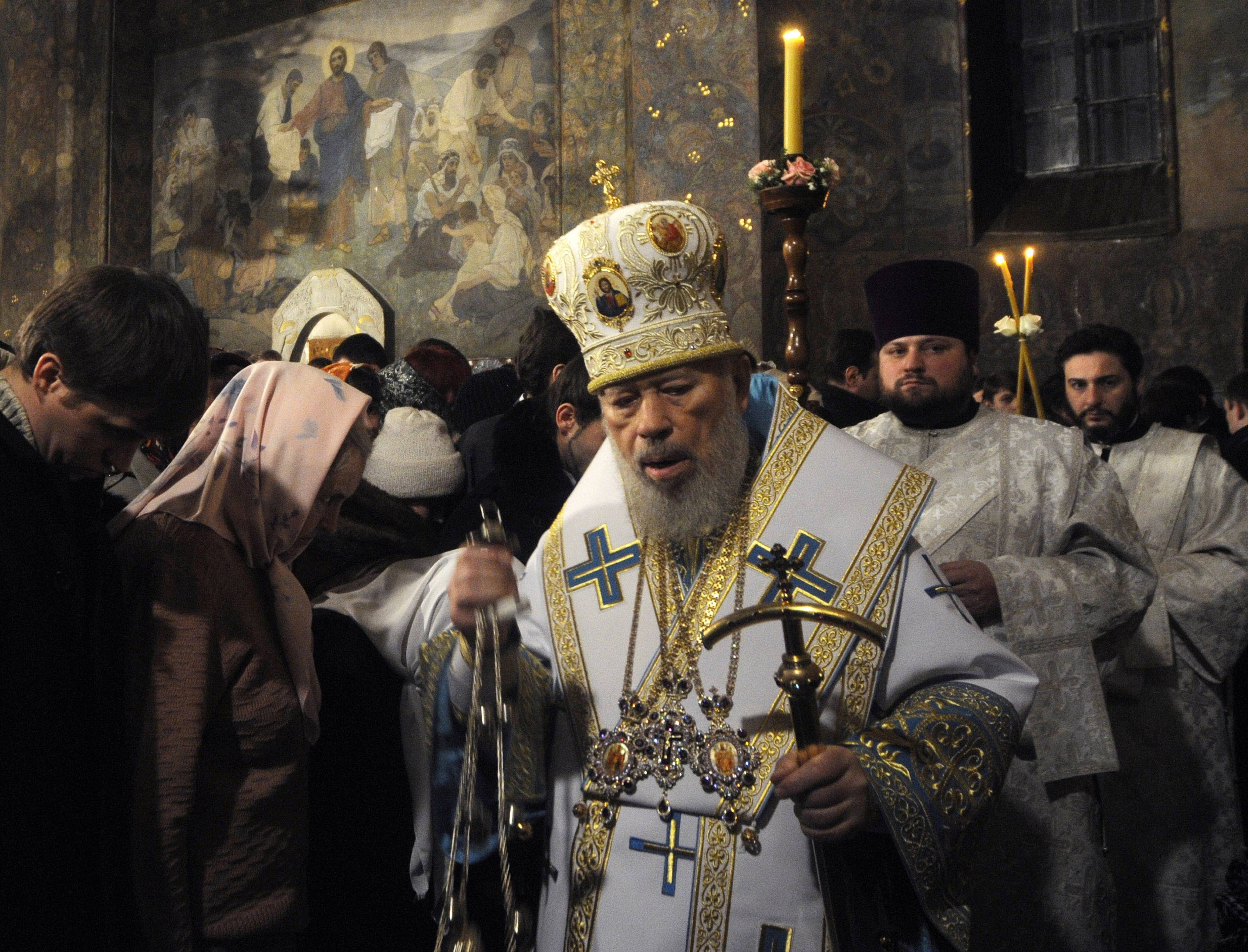 In this file photo taken on Jan. 5, the head of the Ukrainian Orthodox Church under the Moscow Patriarchate, Vladimir leads services during the Christmas Eve mass in the Kyiv-Pechersk Lavra church in Kiev, Ukraine. The head of Ukraine's Orthodox Church under the Moscow patriarchate died on Saturday, July 5, the patriarchate announced on its website. Vladimir, 78, ascended to the leadership of the Ukrainian Orthodox Church following the schism, during which its previous head was defrocked. Vladimir suffered from internal bleeding and had been treated at a clinic in Kiev, Interfax reported.