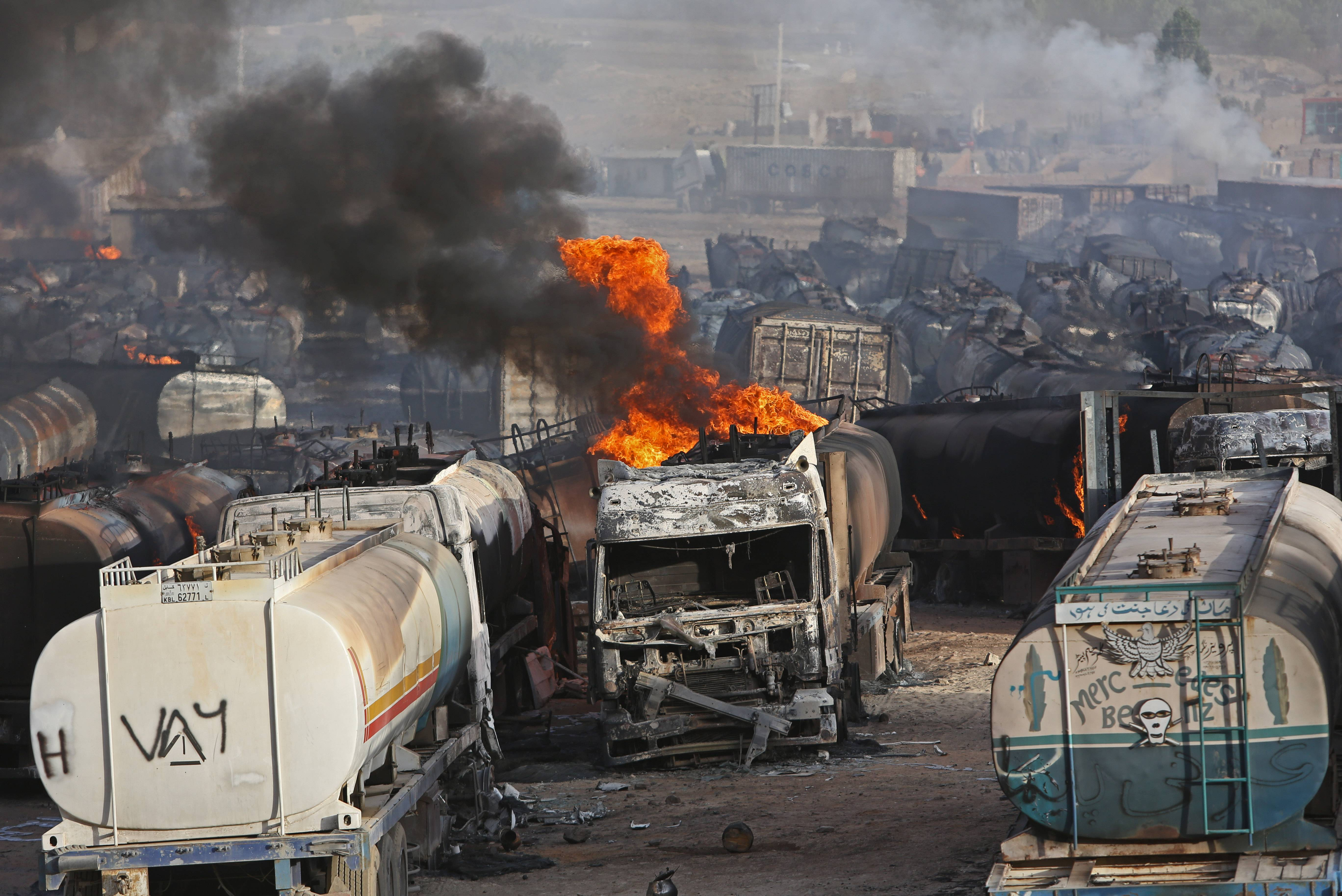 Flames rise from oil tankers after an attack claimed by Taliban militants on the outskirts of Kabul, Afghanistan, Saturday, July 5. An Afghan security official says at least 400 fuel tankers caught fire late Friday night in a parking lot in the outskirts of Kabul.