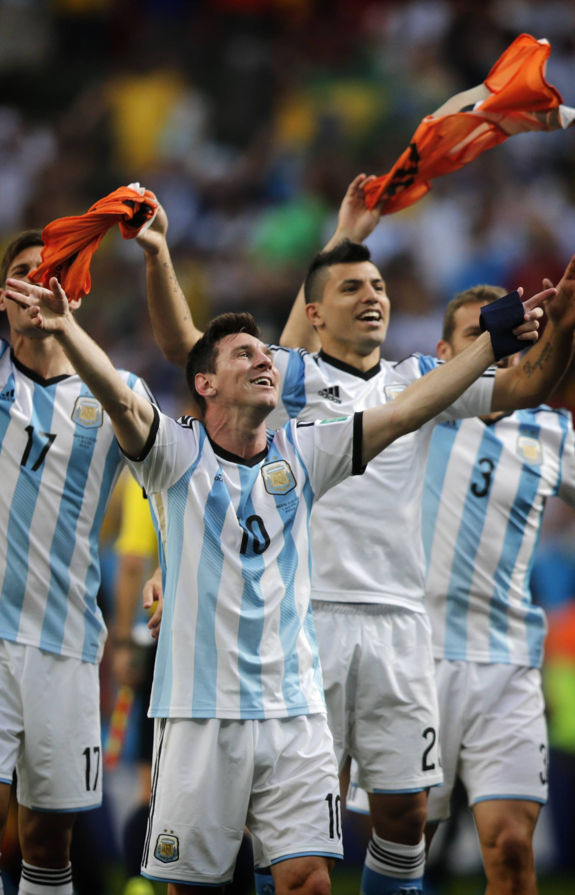 Argentina's Lionel Messi and teammates celebrate at the end of their World Cup quarterfinal soccer match against Belgium Saturday at the Estadio Nacional in Brasilia, Brazil.