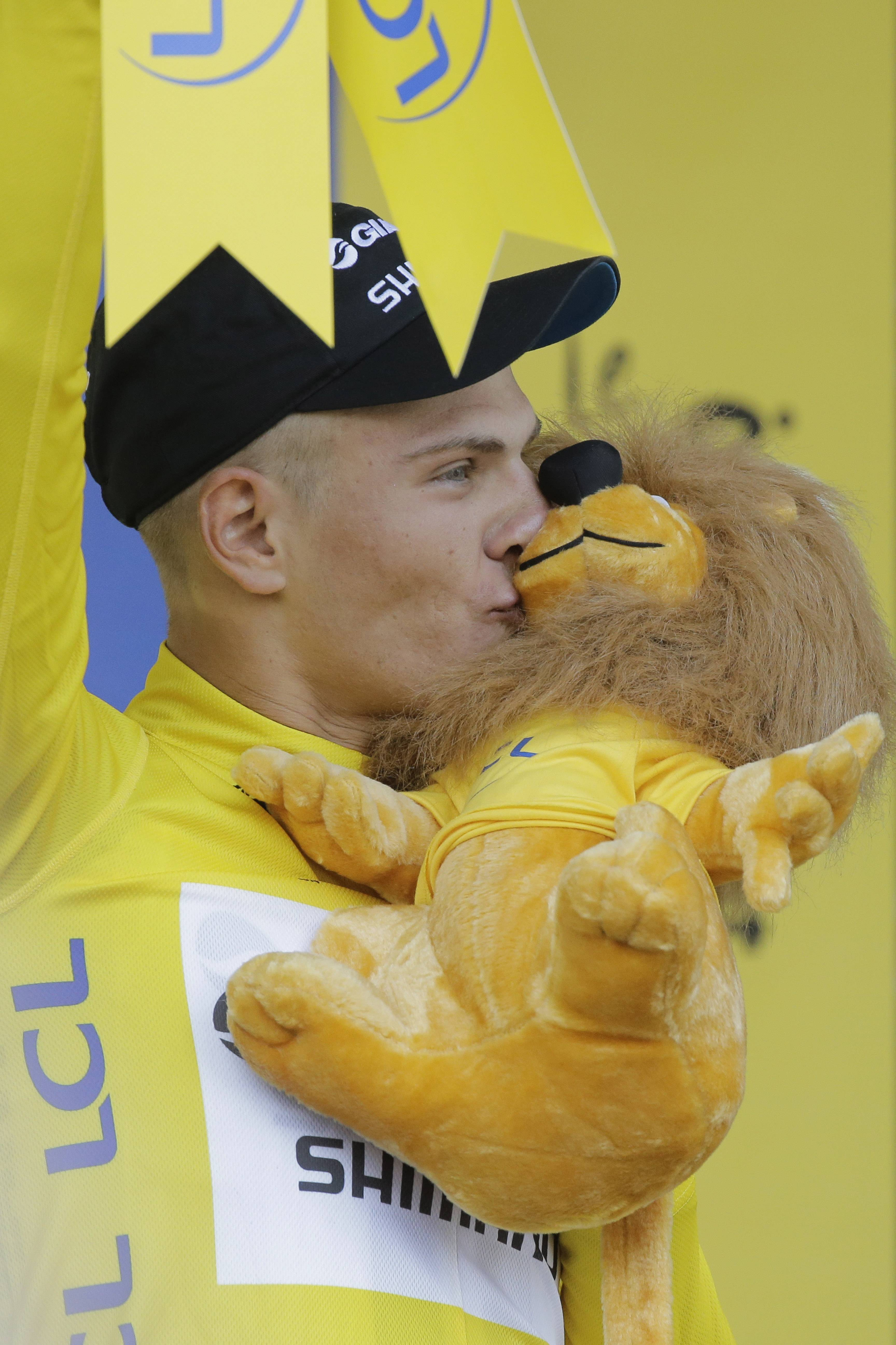Sprinter Marcel Kittel kisses the trophy after winning the first stage and the overall leader's yellow jersey Saturday in the Tour de France, which started in Leeds and finished in Harrogate, England.