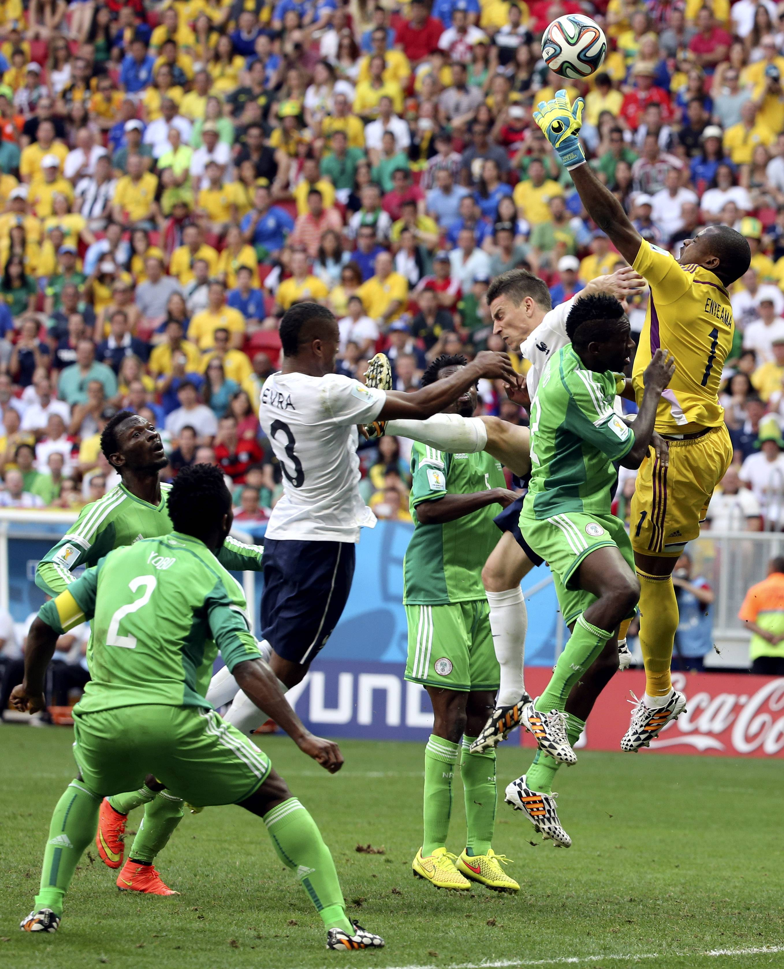 Nigeria's goalkeeper Vincent Enyeama fails to gather a cross from which France's Paul Pogba scored the opening goal during the World Cup round of 16 soccer match between France and Nigeria at the Estadio Nacional in Brasilia, Brazil, Monday, June 30, 2014.