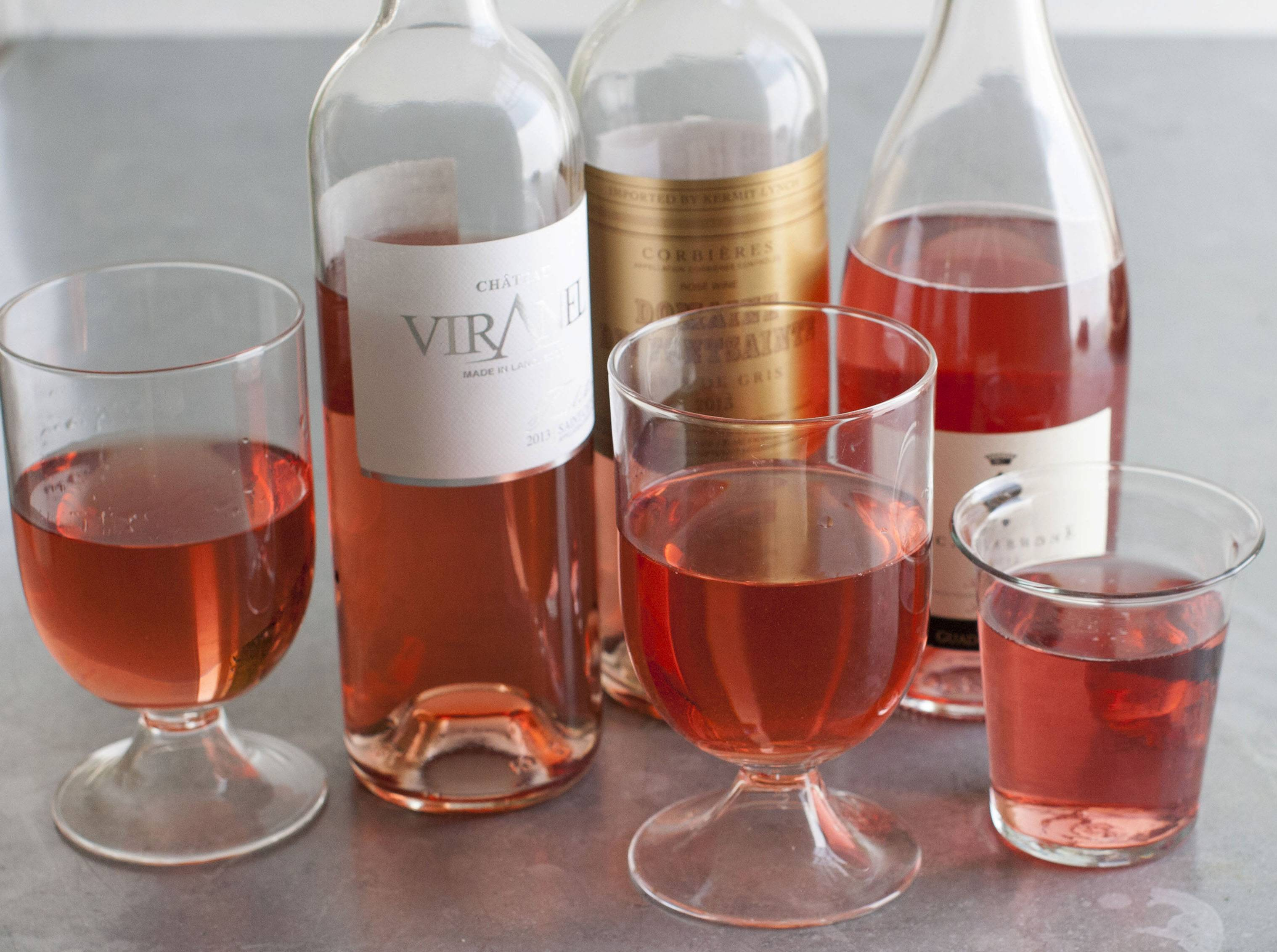 This June 2, 2014 photo shows left to right, Chateau Viranel, Domaine De Fontsainte and Scalabrone rose wines in Concord, N.H.