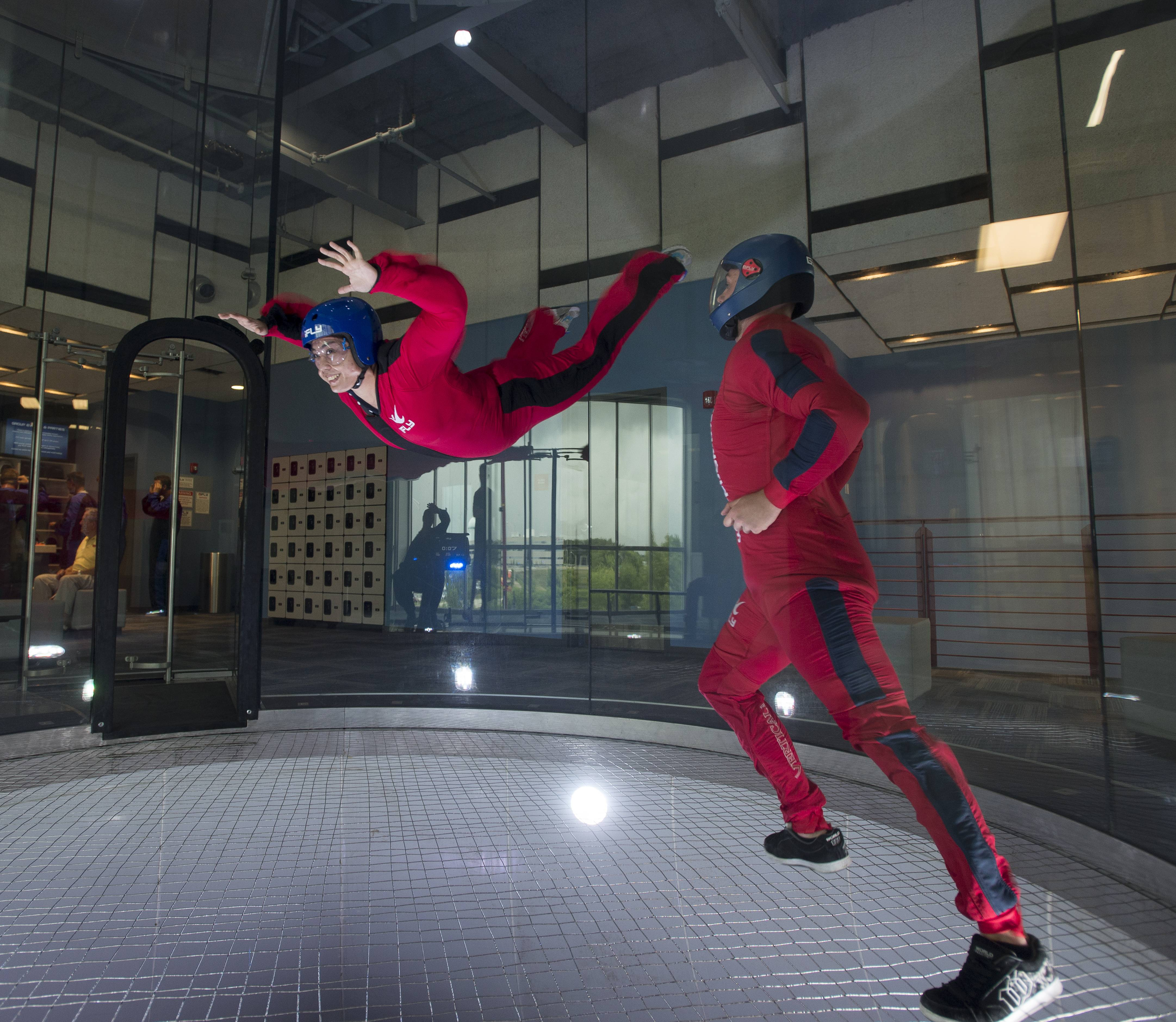 Genevieve Nacario of Lisle tries out the new iFly indoor sky-diving venue, which opened Friday in Naperville.