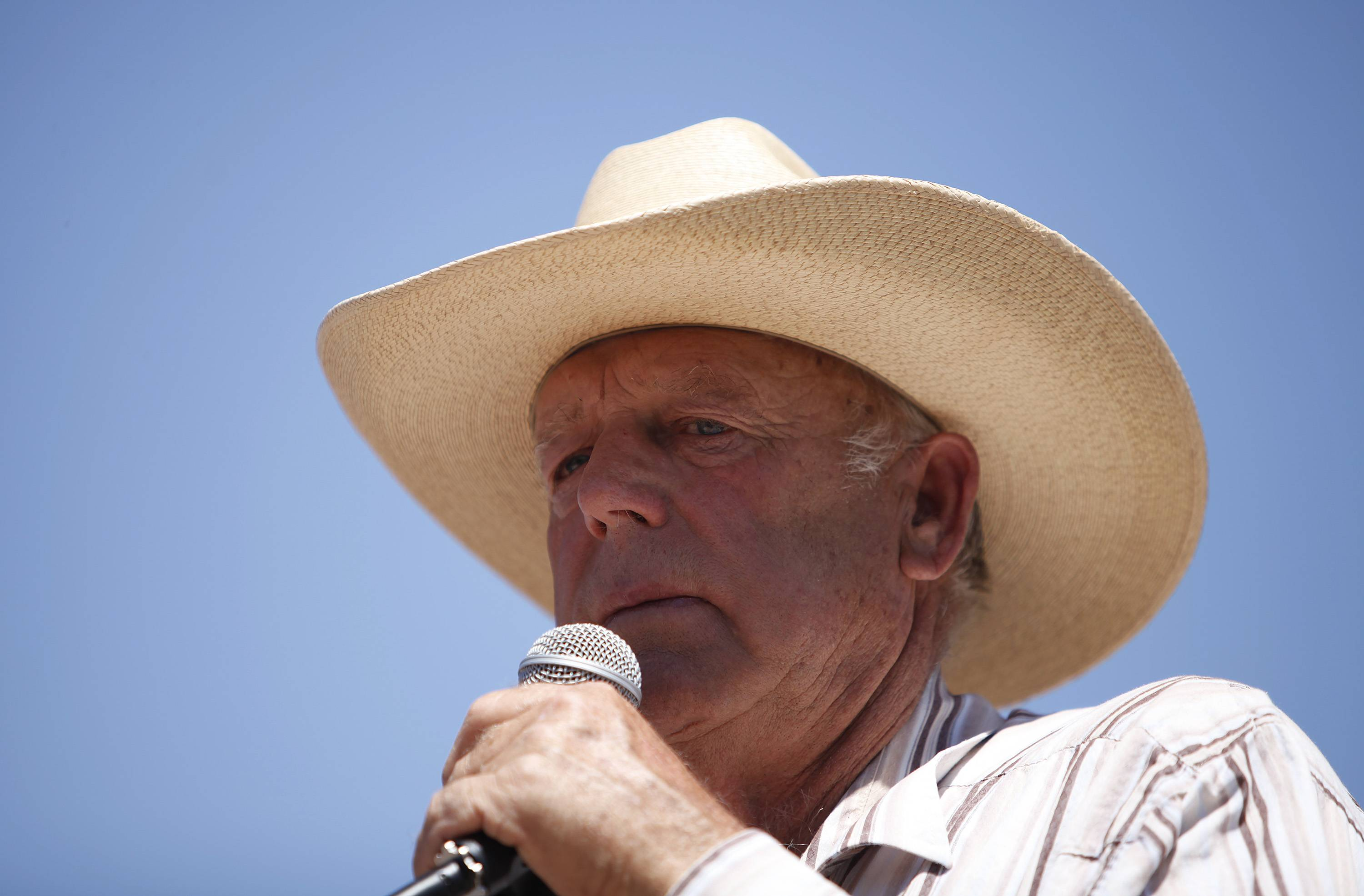 Rancher Cliven Bundy speaks at a news conference near Bunkerville, Nev. U.S. Bureau of Land Management officials say they agree with a Nevada sheriff's position that rancher Bundy must be held accountable for his role in an April standoff between his supporters and the federal agency. Clark County Sheriff Doug Gillespie said Bundy crossed the line when he allowed states' rights supporters, including self-proclaimed militia members, onto his property to aim guns at police.