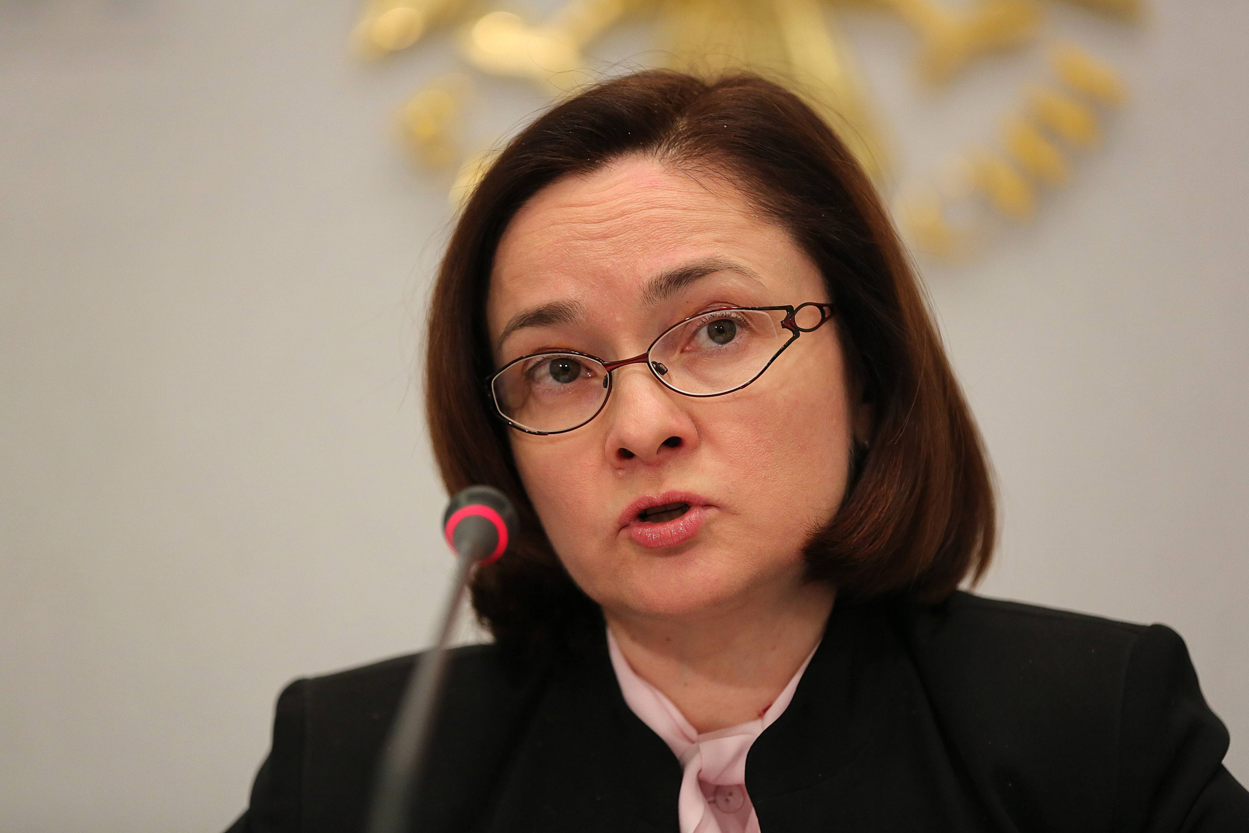 Elvira Nabiullina, chairman of Russia's central bank, speaks during a briefing at the headquarters of Bank Rossii in Moscow, Russia, on Friday, Feb. 14, 2014. Nabiullina signaled readiness to follow countries including India, Turkey and South Africa in tightening monetary policy after the ruble's plunge to a record low this month increased inflation risks.