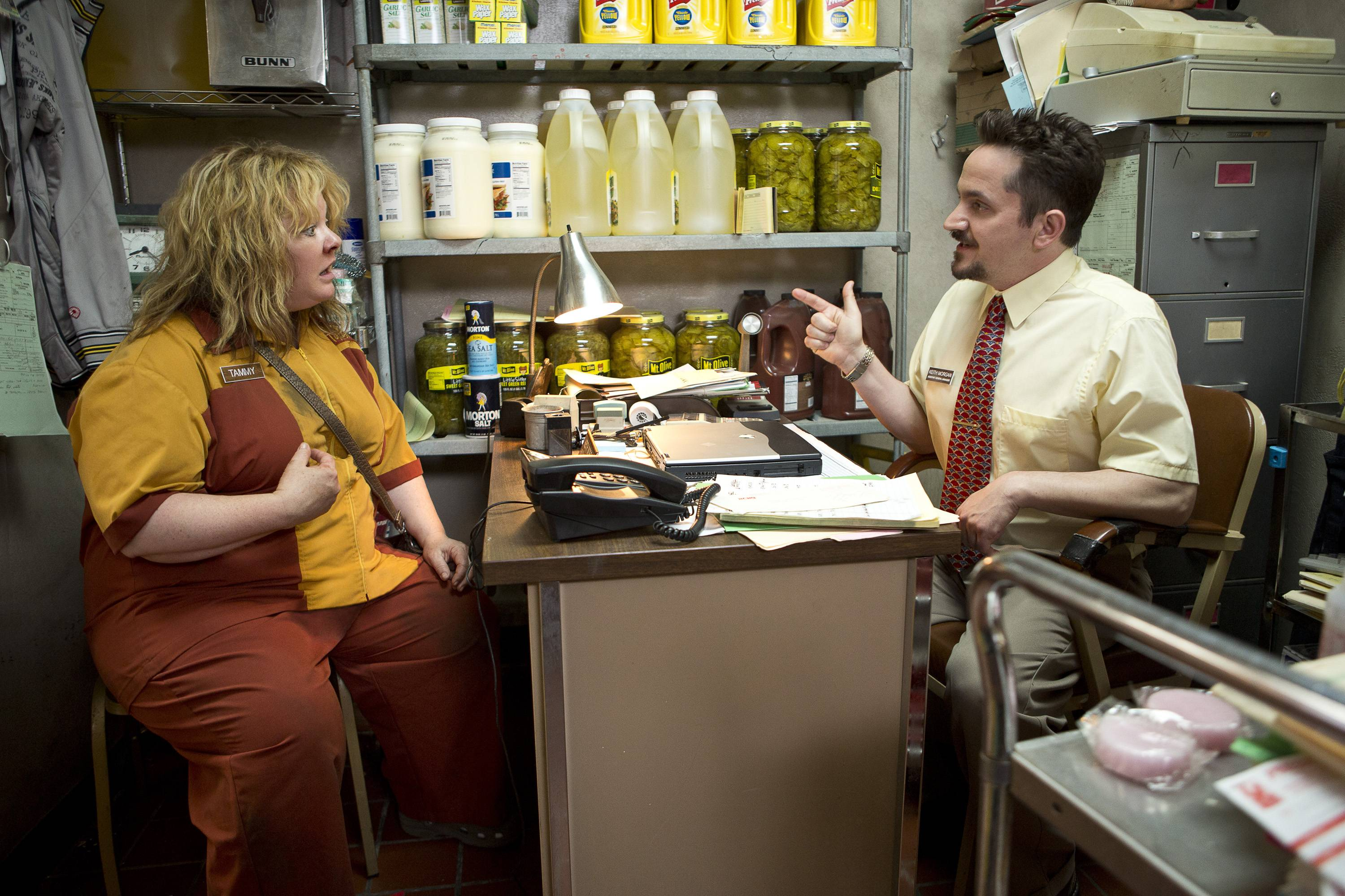 "Melissa McCarthy, left, gets a talking to from her boss, real-life husband Ben Falcone, in ""Tammy."""