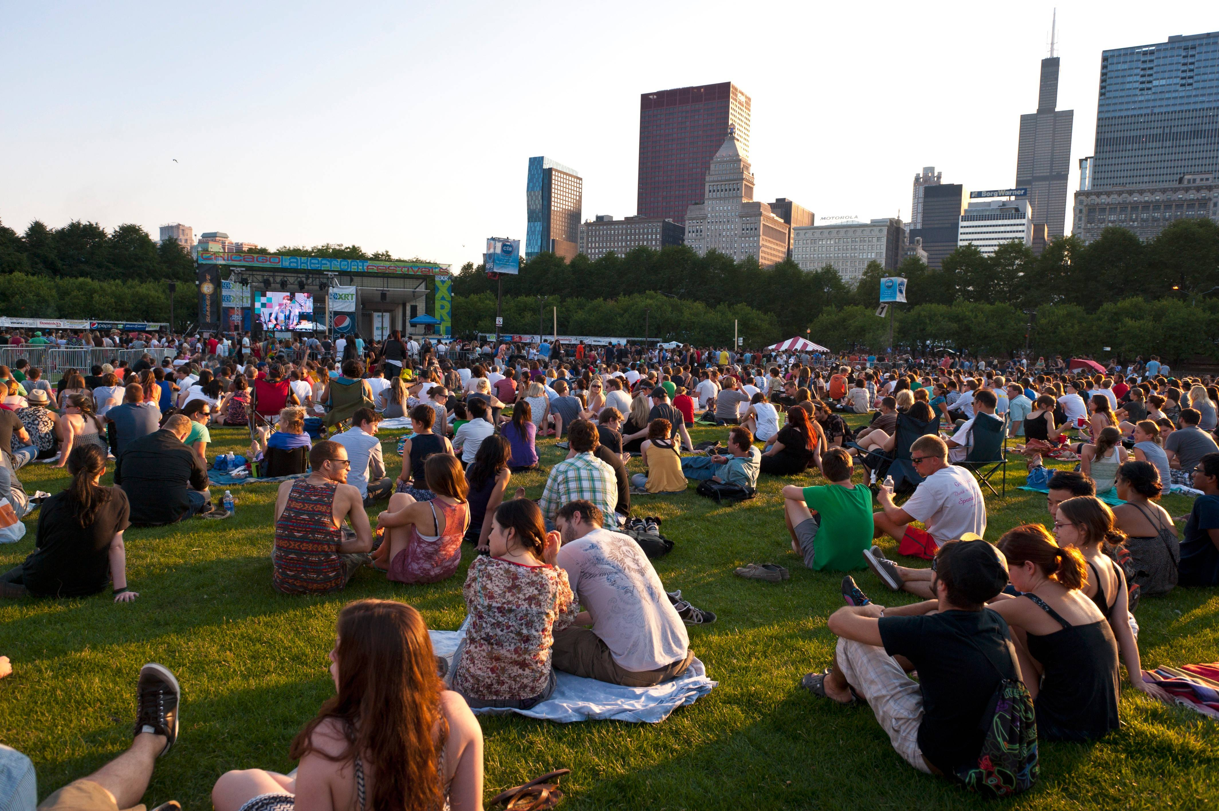 Crowds settle in early to enjoy the free Taste of Chicago concerts at the Petrillo Music Shell.