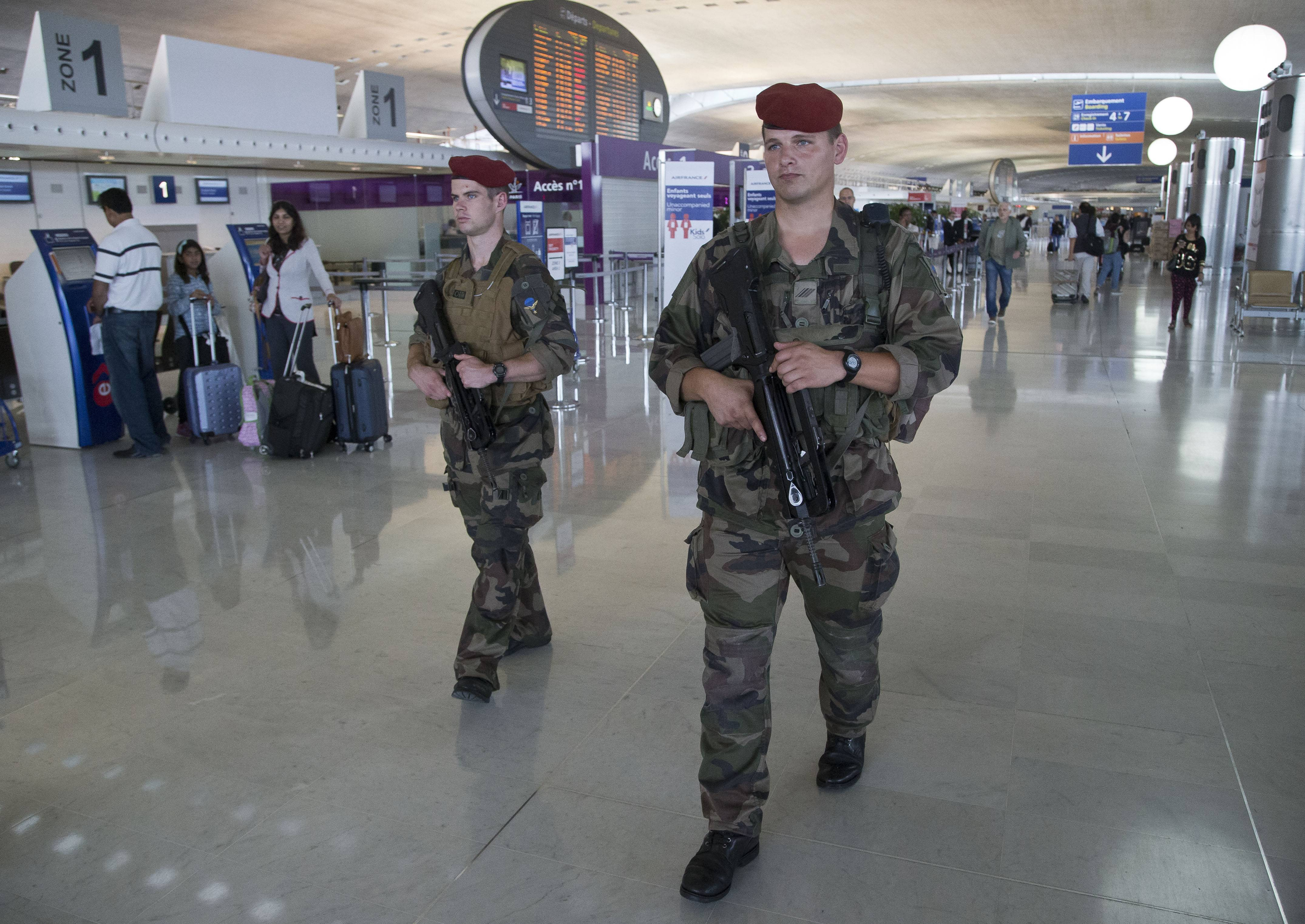 "Soldiers patrol a terminal at Paris Charles de Gaulle airport in Roissy, France. Friday, when the French civil aviation authority announced stepped-up security measures ""for the summer period."""