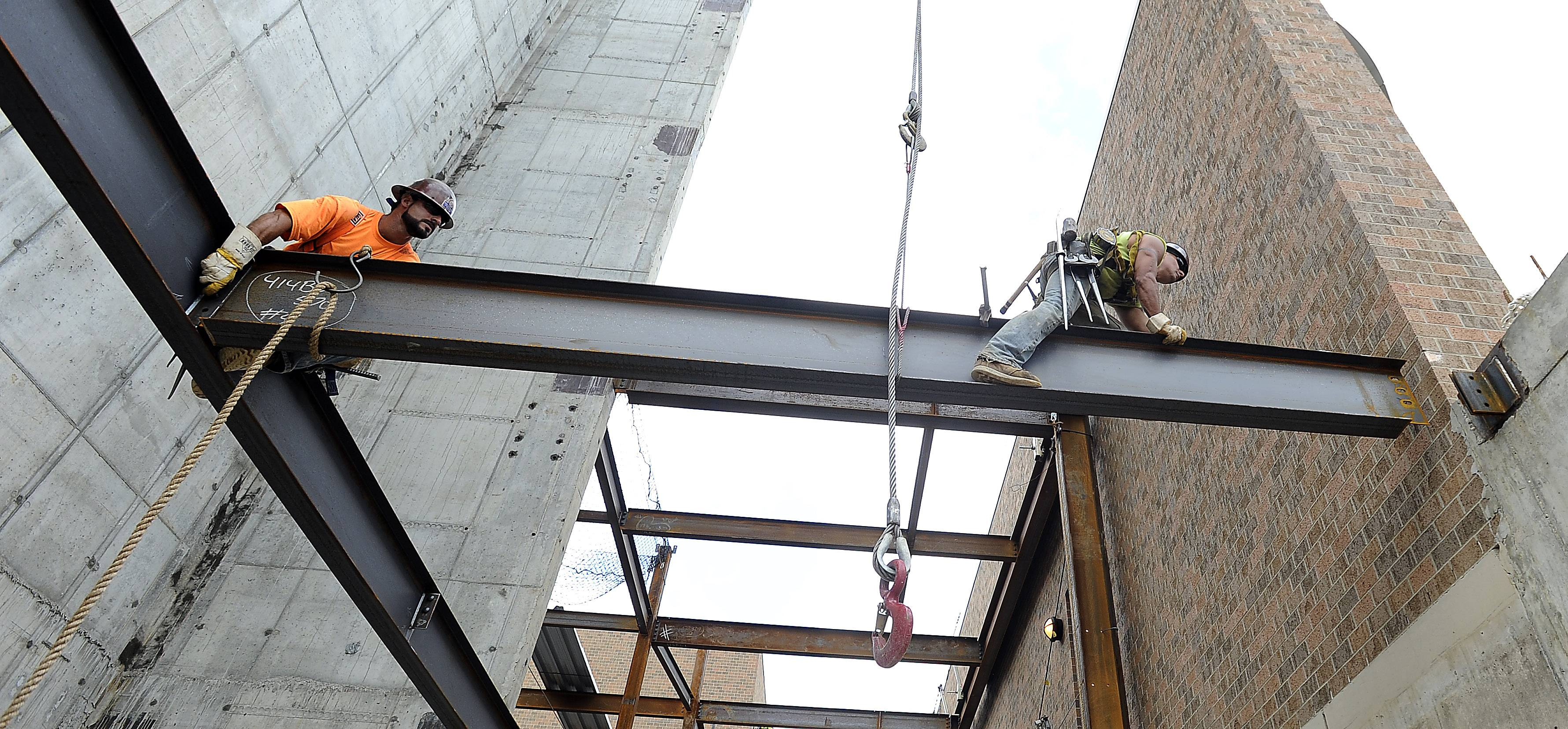 Tony Mici and Joe Gonzalez position a steel beam as part of the work to build a new entrance at Advocate Good Shepherd Hospital near Lake Barrington. The entrance is part of a $247 million hospital modernization project expected to be complete in 2017.