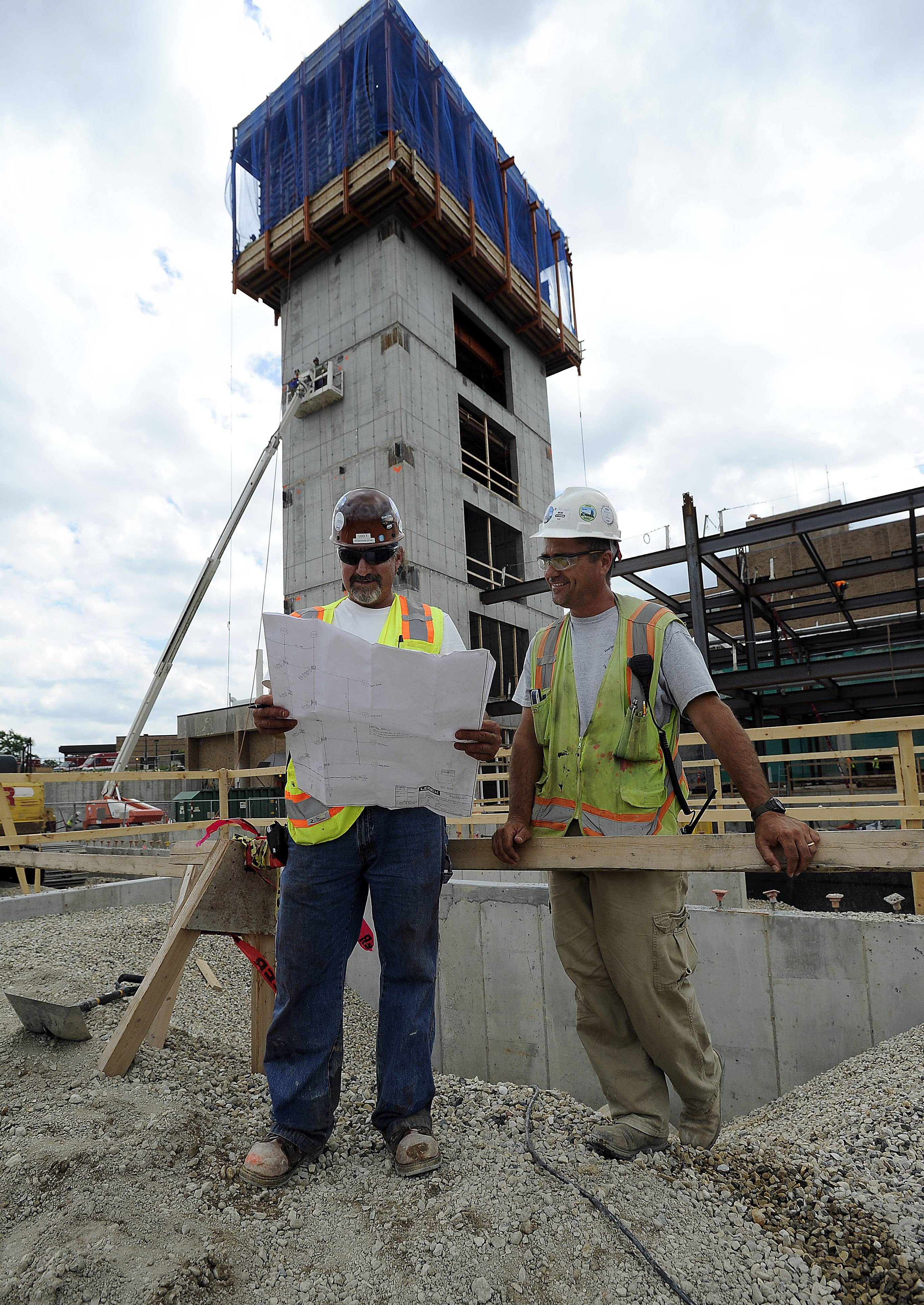Technical engineers Leo Pamosiunas and Mike Kundrat look over plans that are part of the $247 million modernization effort at Advocate Good Shepherd Hospital near Lake Barrington. The work includes a new main entrance and an addition that will allow for single-only rooms at the facility.