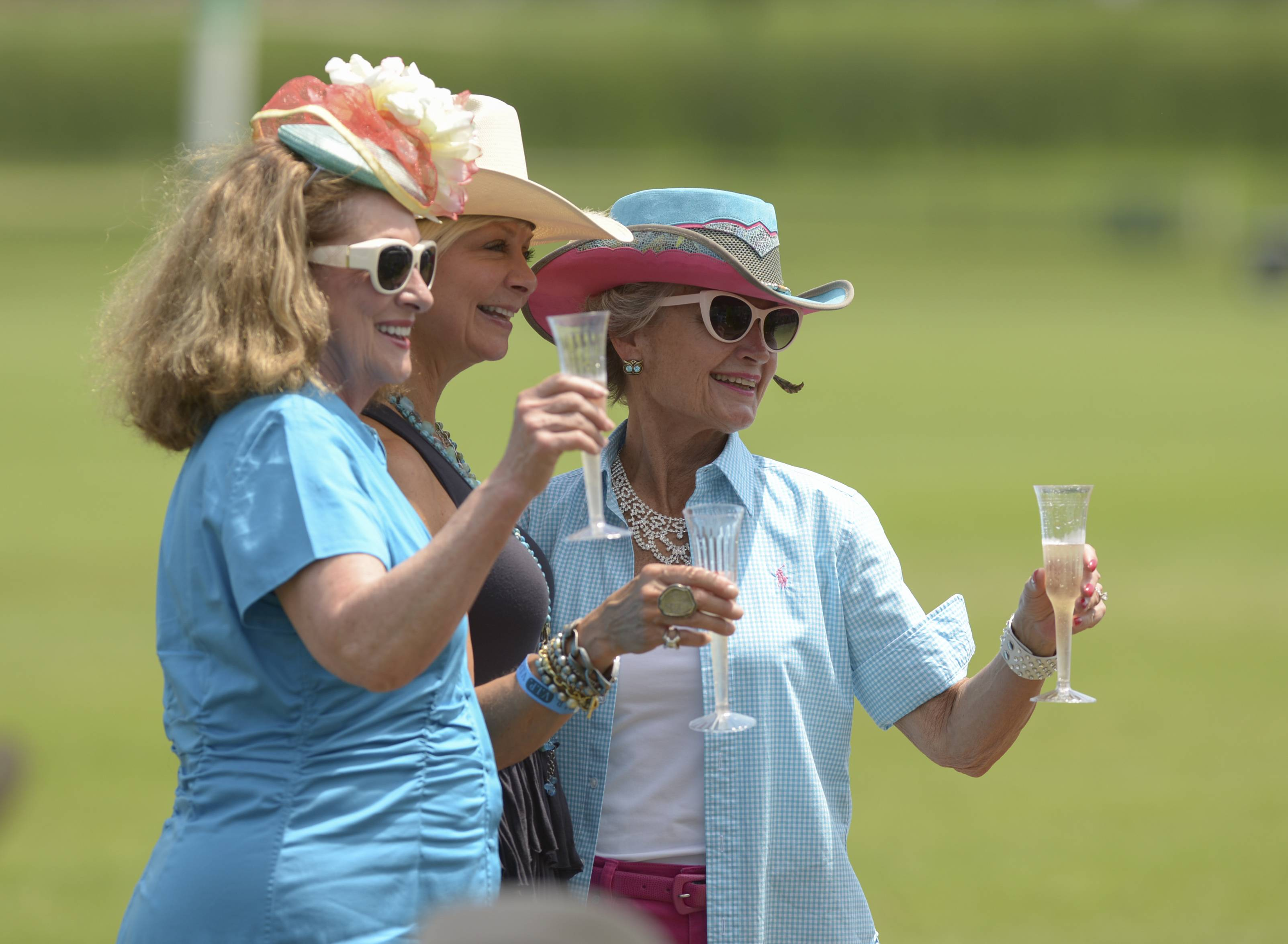 "Nancy Gibson of Oak Brook, C.J. Grad of Lemont and Marje Pehta of Oak Brook pose for a photo in their hats as the Oak Brook Polo Club celebrates the 89th anniversary of polo in Oak Brook this year with ""Hat Day"" Sunday."