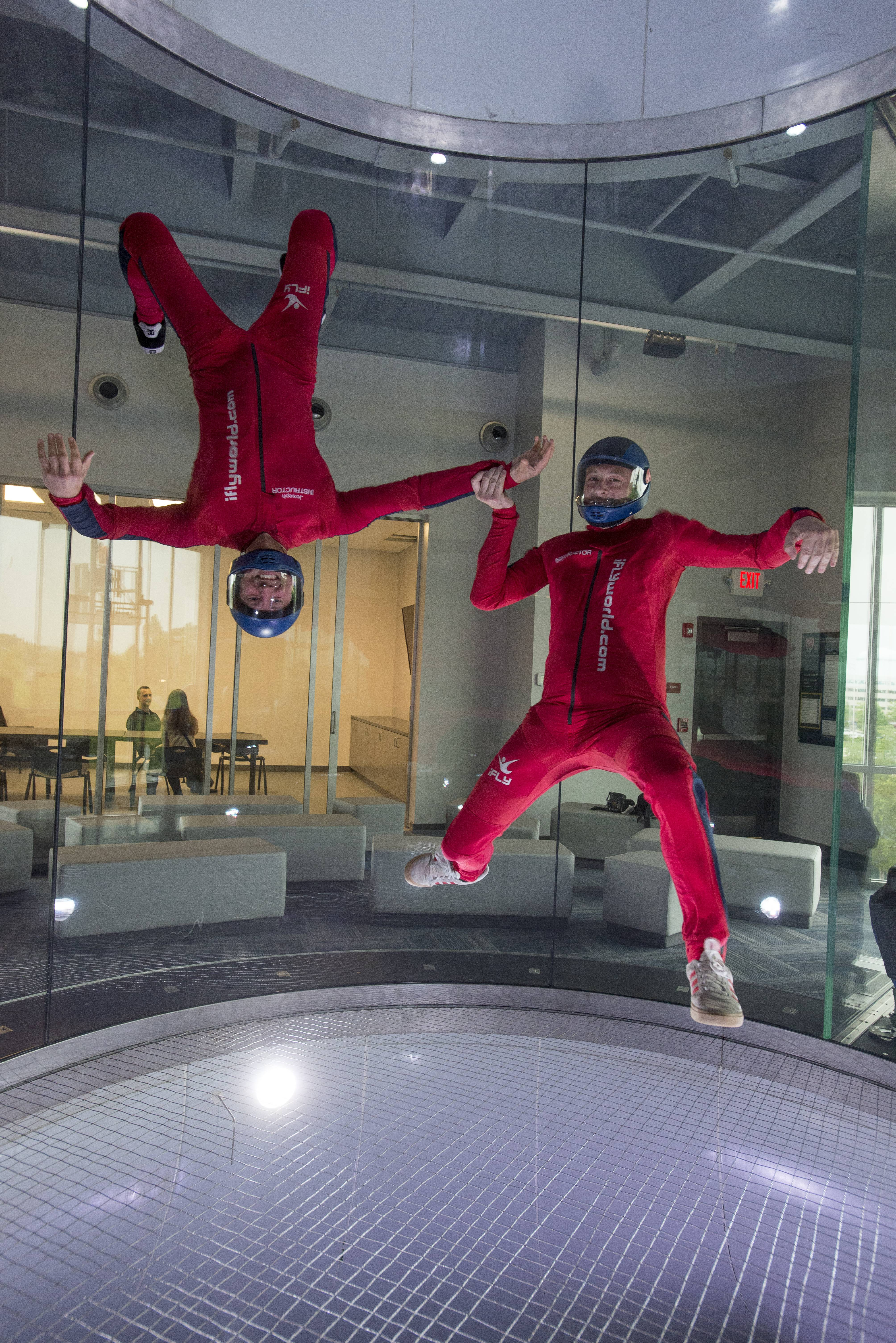 iFly instructors Joey Mire and Gabe Roth perform some stunts at the new indoor sky-diving venue in Naperville.