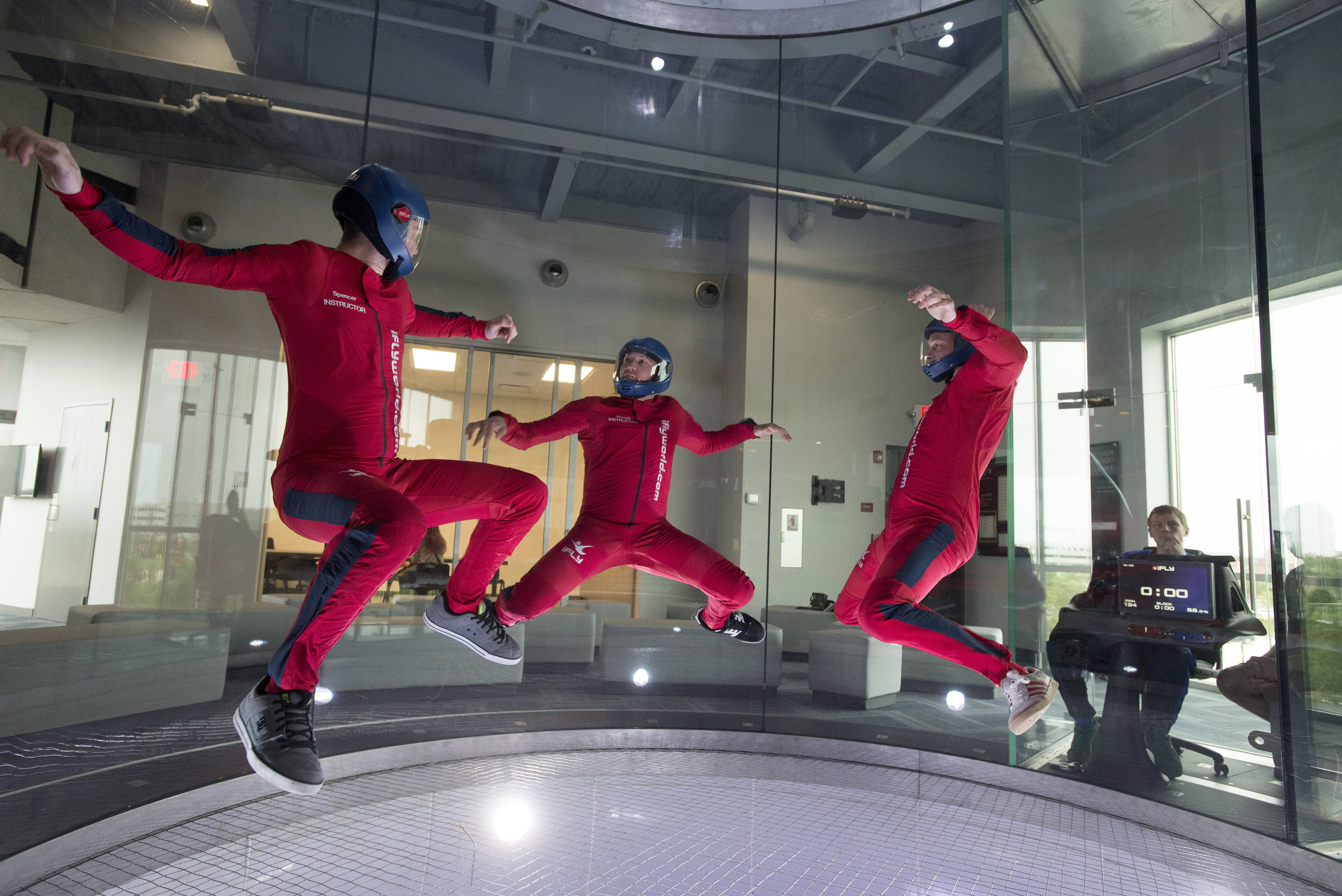 Instructors perform some stunts in the flight chamber at the new indoor sky-diving center in Naperville. The facility on Freedom Drive is the second iFly in the area, opening two months after the first venue came to Rosemont.