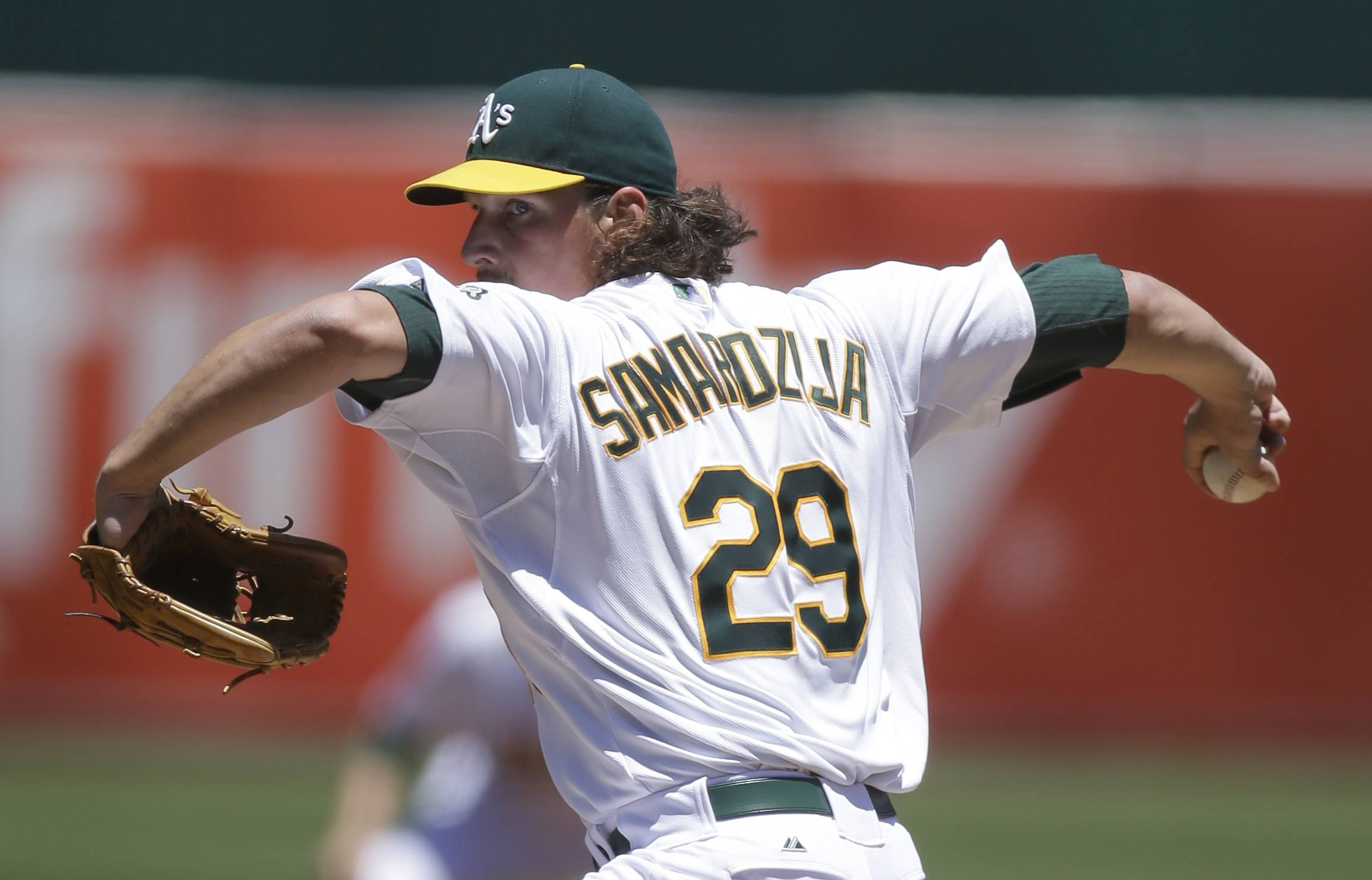 Oakland Athletics' Jeff Samardzija works against the Toronto Blue Jays in the first inning of a baseball game Sunday, July 6, 2014, in Oakland, Calif.