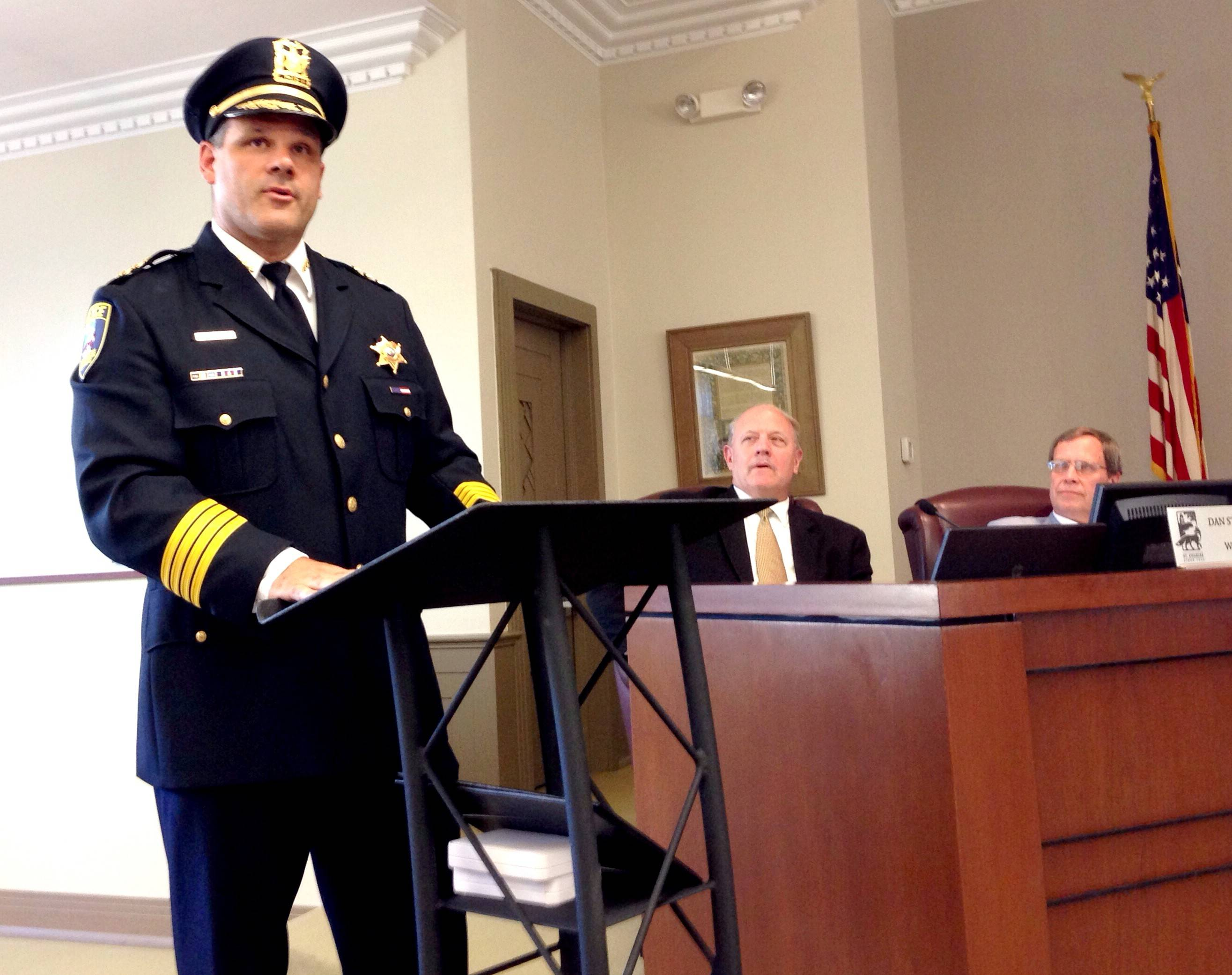 New St. Charles Police Chief James Keegan delivered his first address to the community Monday night as Aldermen Dan Stellato, center, and Ron Silkaitis, right, looked on.