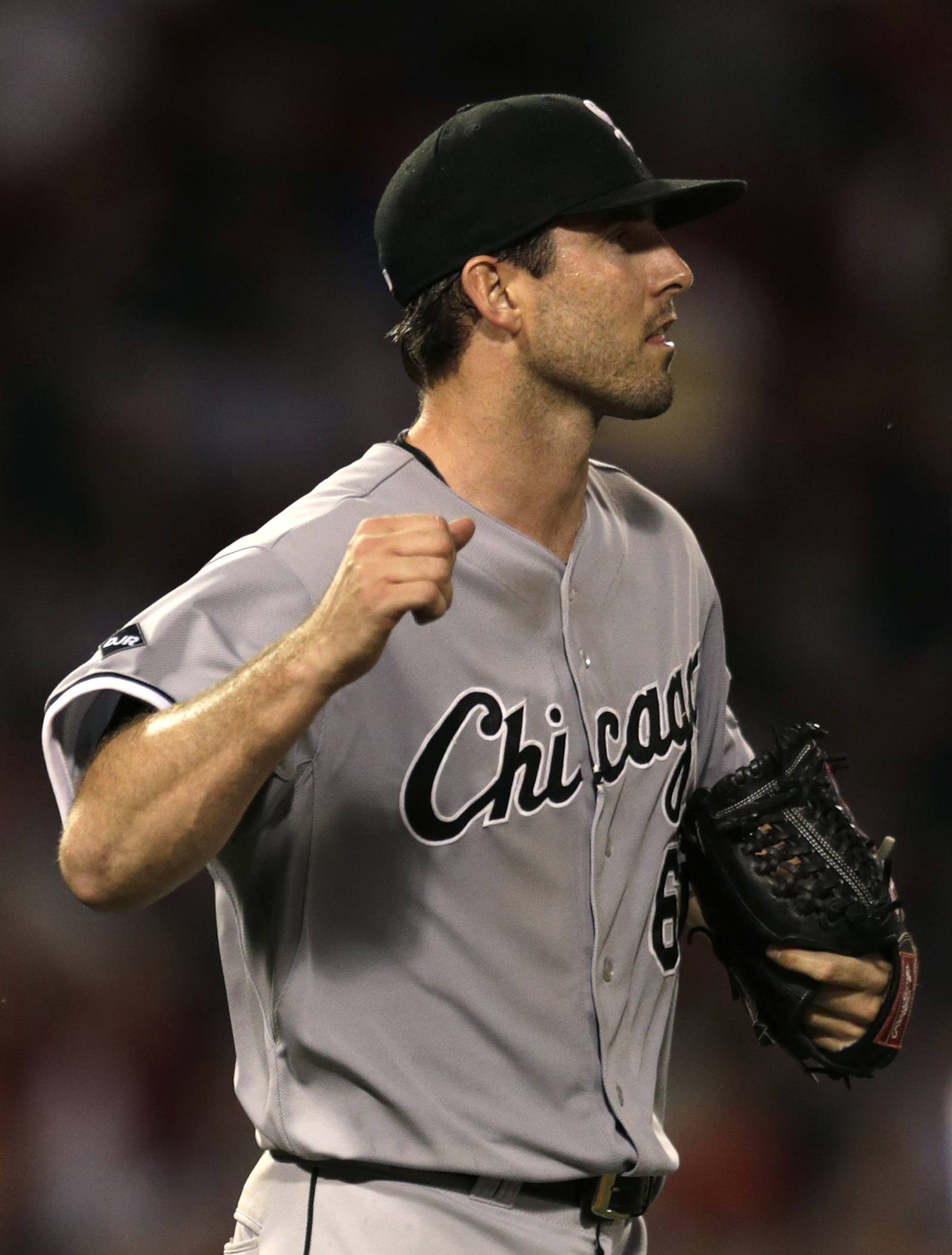 White Sox starting pitcher Scott Carroll pumps his fist after getting the Red Sox' Brock Holt to ground out to end the sixth inning Monday night. Carroll allowed only 1 hit in 6⅔ innings to earn the 4-0 victory.