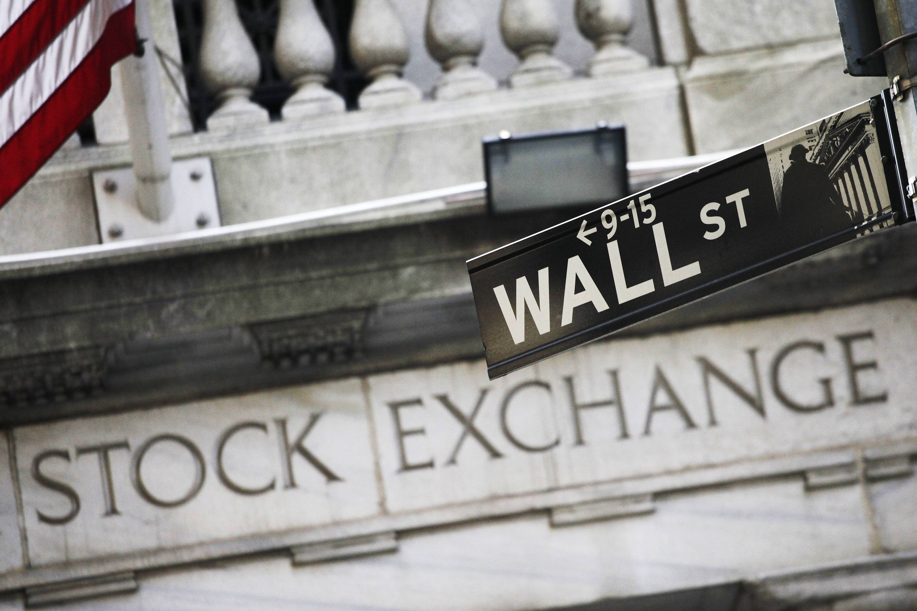 After pushing stock indexes to record highs last week, investors turned cautious on Monday ahead of a batch of corporate earnings reports.
