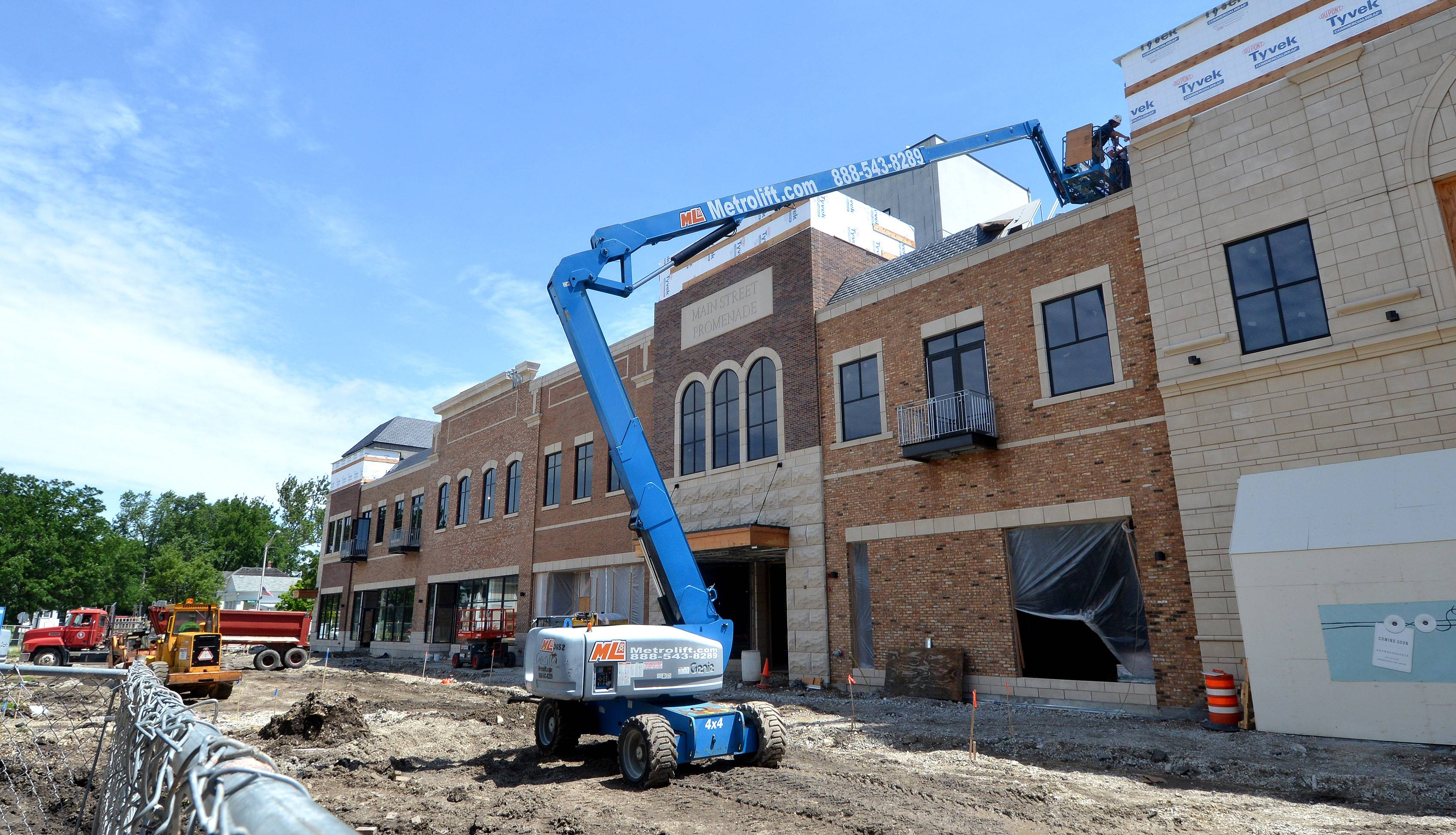 Work on Main Street Promenade East continues in downtown Naperville, as stores in the development aim to begin opening as soon as August.