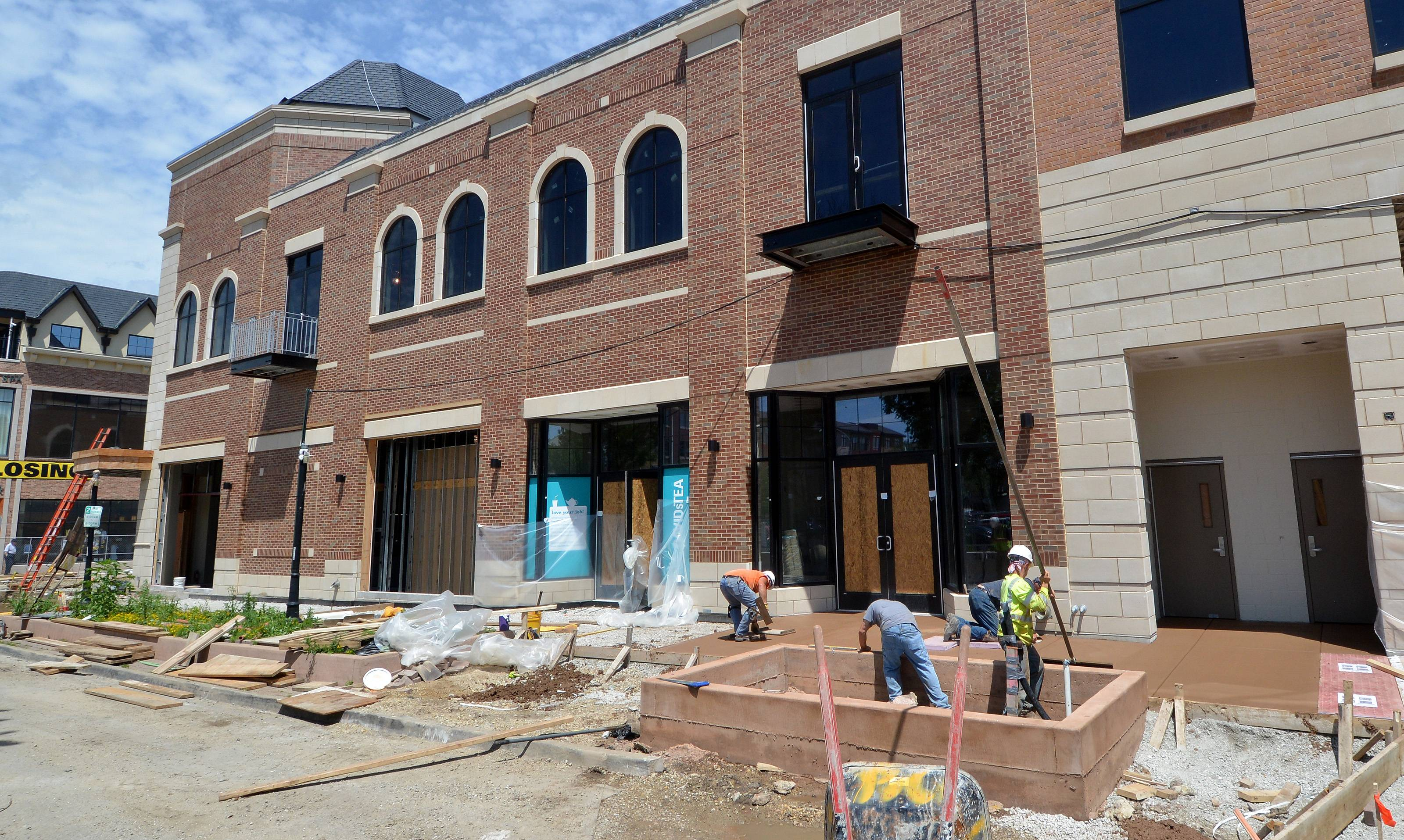 Work on electric infrastructure, sidewalks, streets and a new retail and office building continues in downtown Naperville as Main Street Promenade East prepares to welcome new stores as soon as August.