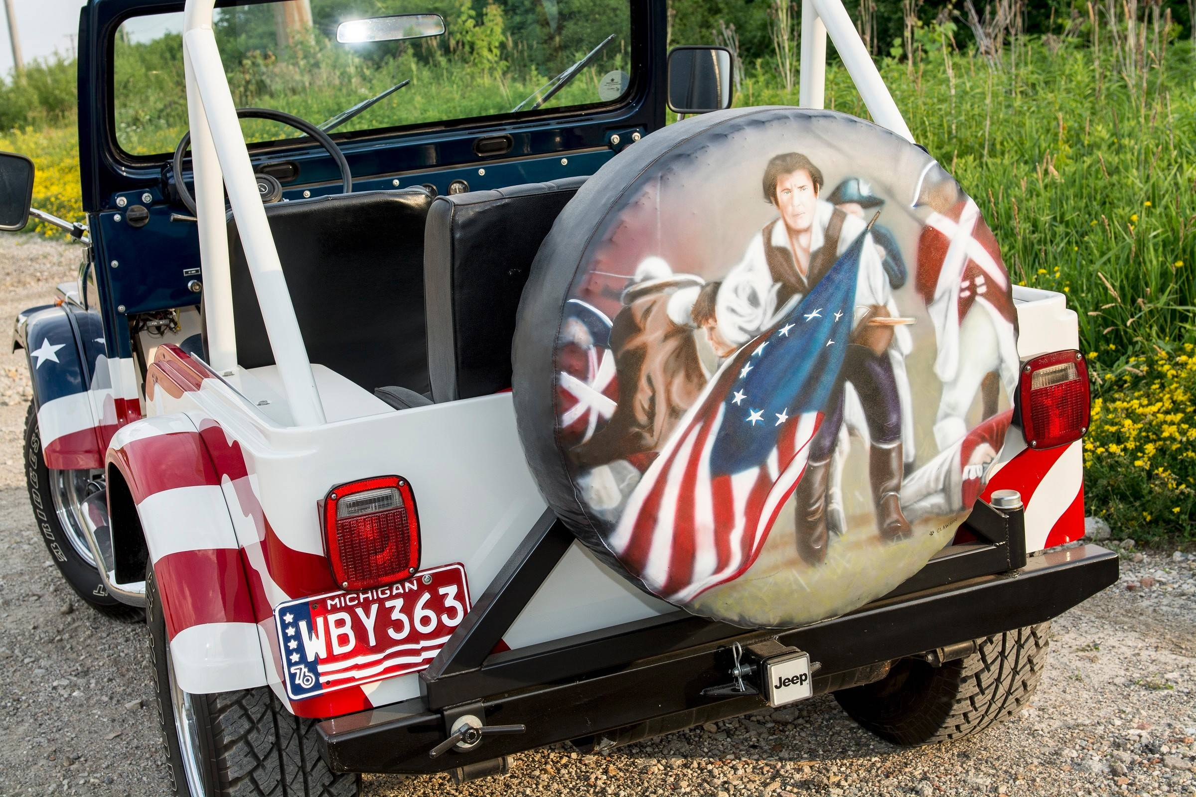 Retired Jeep painter Paul Clawson also airbrushed the tire cover on the rear of the '76 CJ-5.