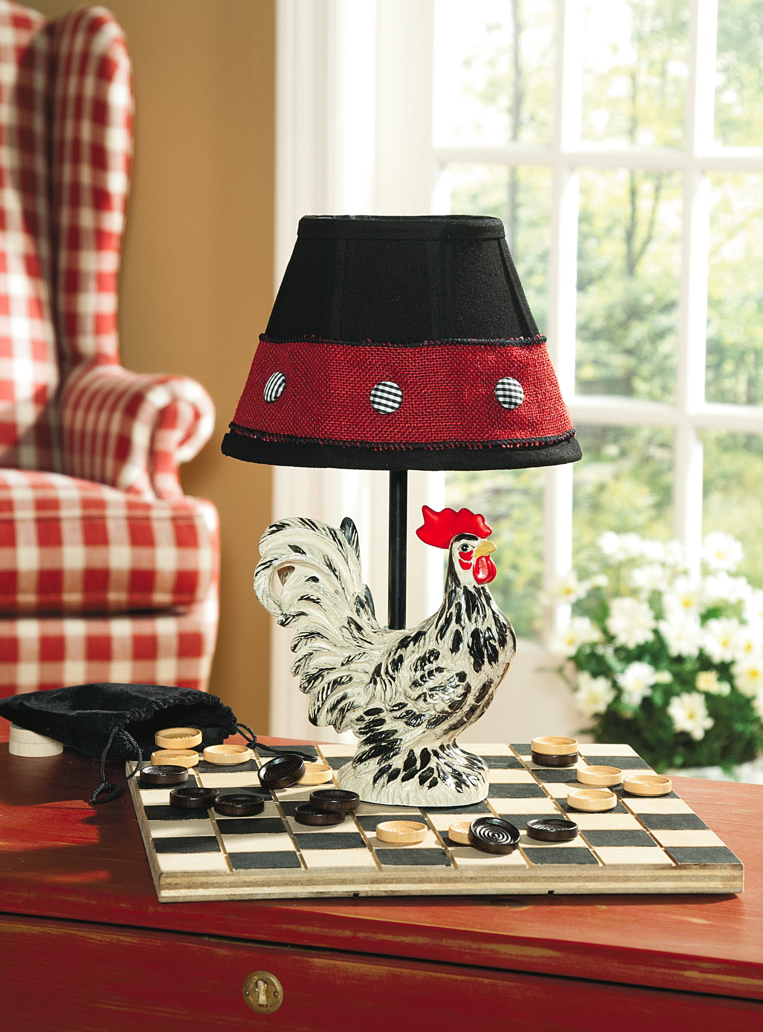 Repeat a room's palette anywhere you think it works -- for instance, this chicken lamp continues the black, red and white color scheme found on the porch and in the entryway.