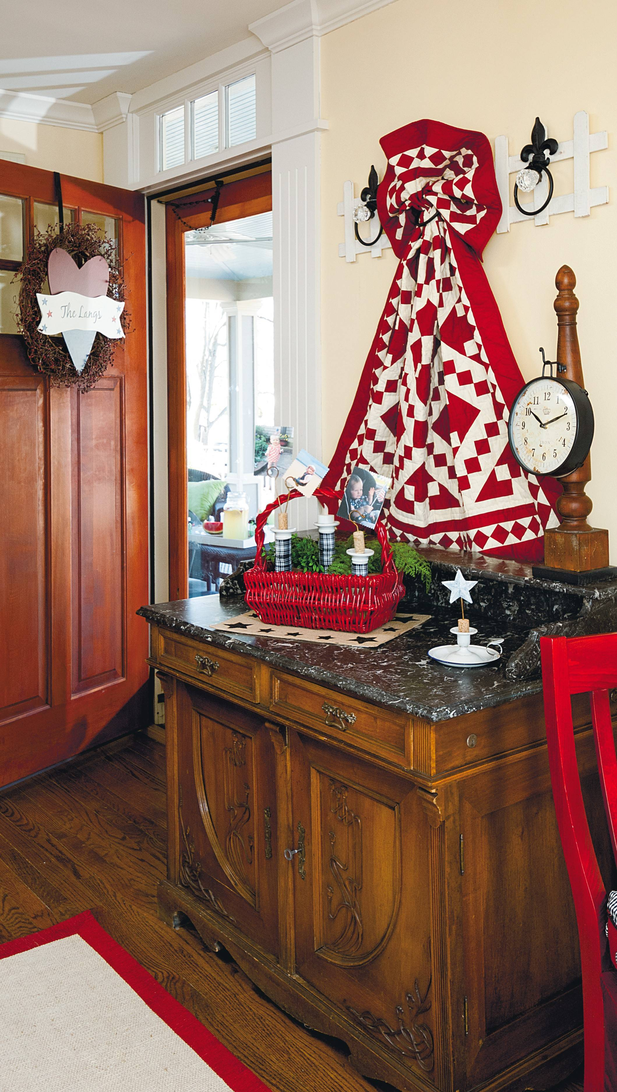 Announce your love of country to anyone who enters with Americana front-door decor, such as this berry wreath featuring a painted heart.