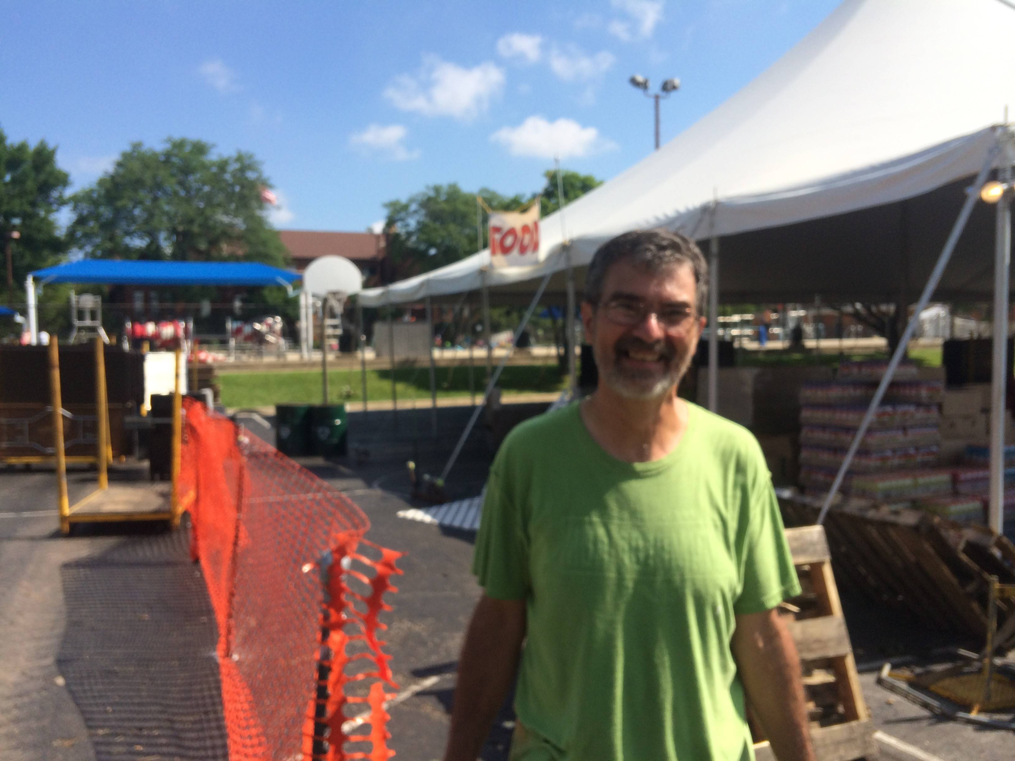 Tom Hahn, 65, of Arlington Heights volunteers to clean up the Frontier Days festival on Monday. Boosted by good weather and big-name acts, organizers said this year's fest was a big success.
