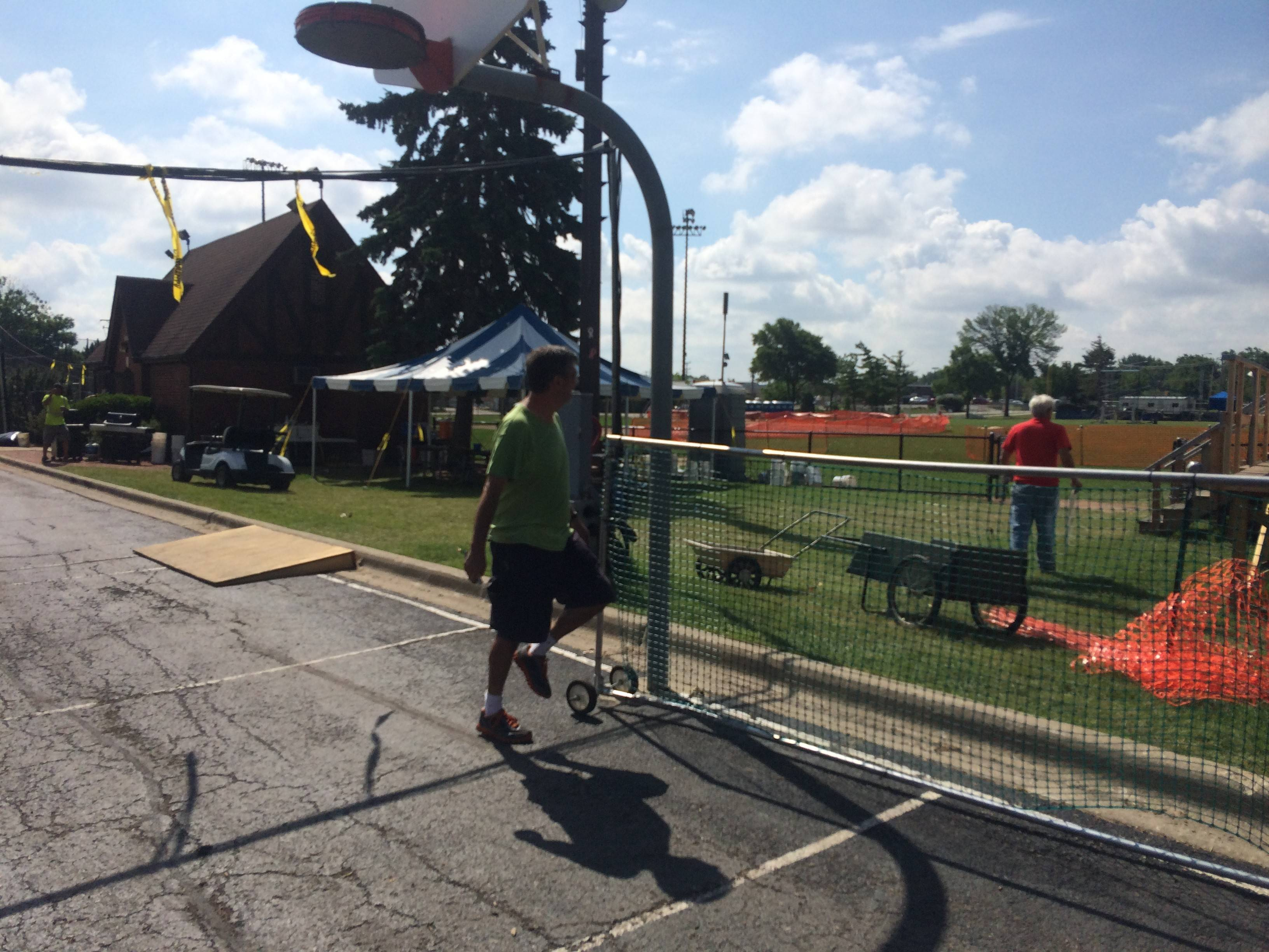 Tom Hahn, 65, of Arlington Heights moves a net while cleaning up the Frontier Days festival in Arlington Heights on Monday.