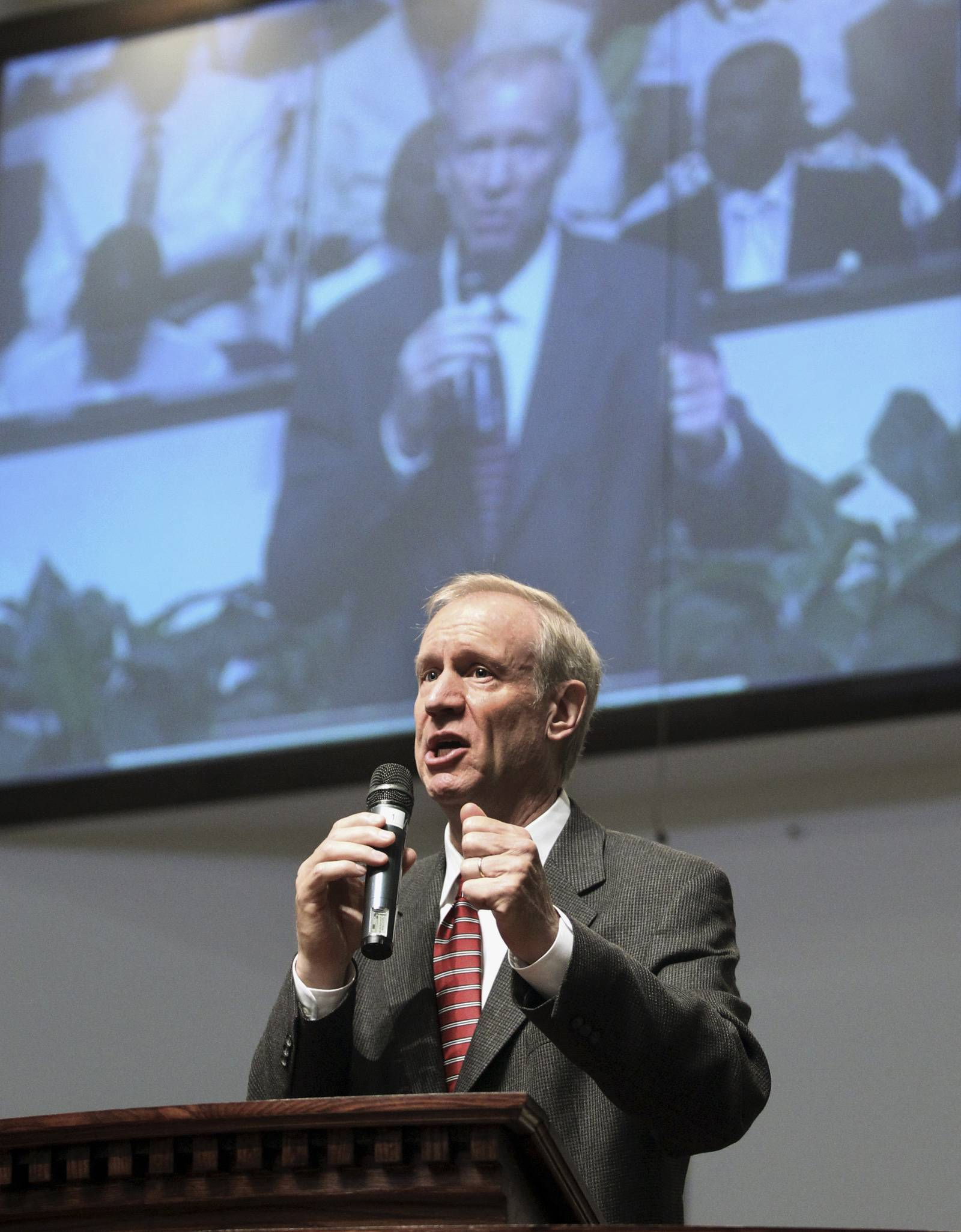 GOP gubernatorial candidate Bruce Rauner talks to the congregation at Chicago church last month about his involvement in community education.