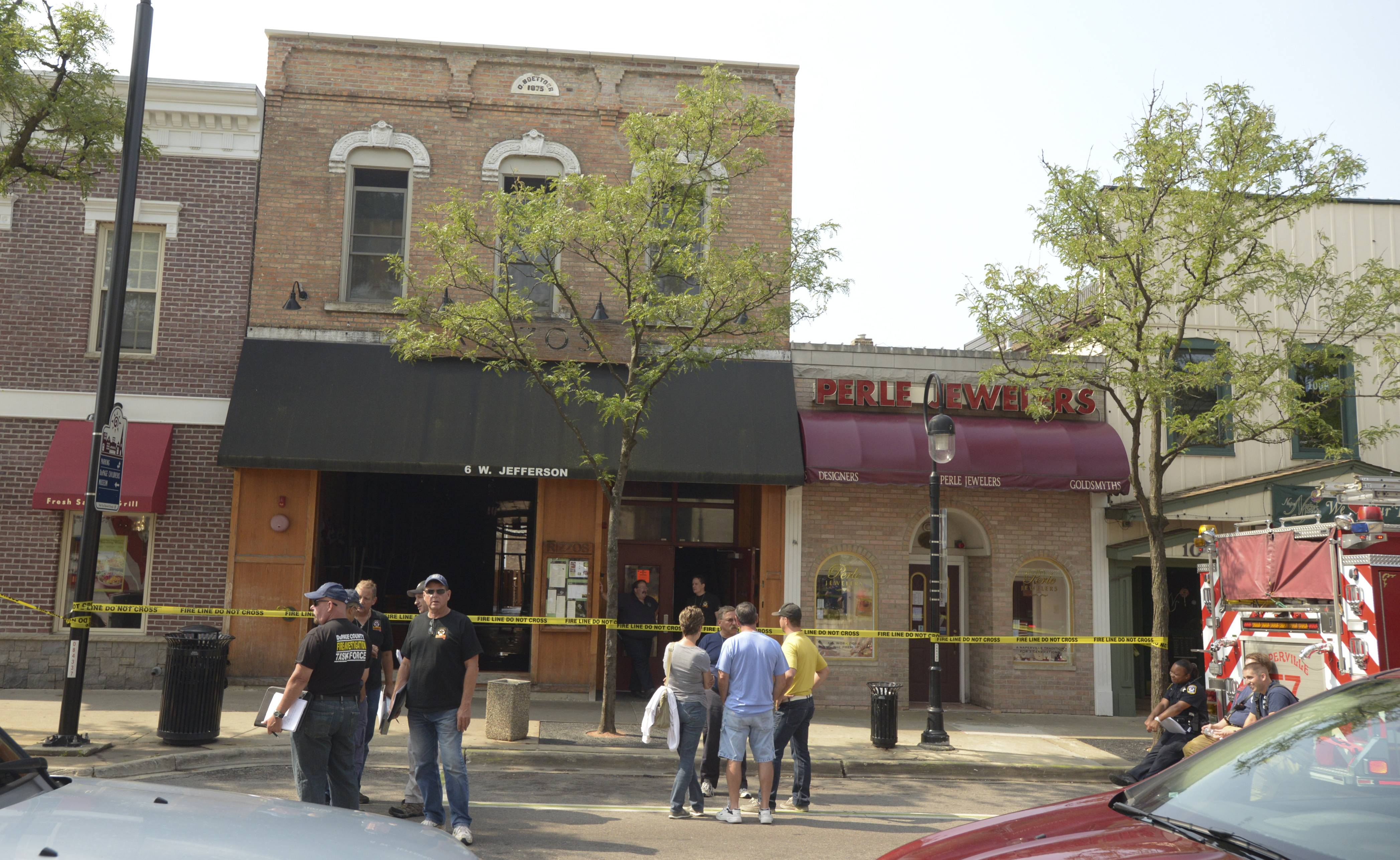 Rizzo's in downtown Naperville remains uninhabitable as investigators work to determine the cause of a fire there Sunday morning that caused $200,000 in damage. The fire started on the roof or back porch then spread inside, authorities said.